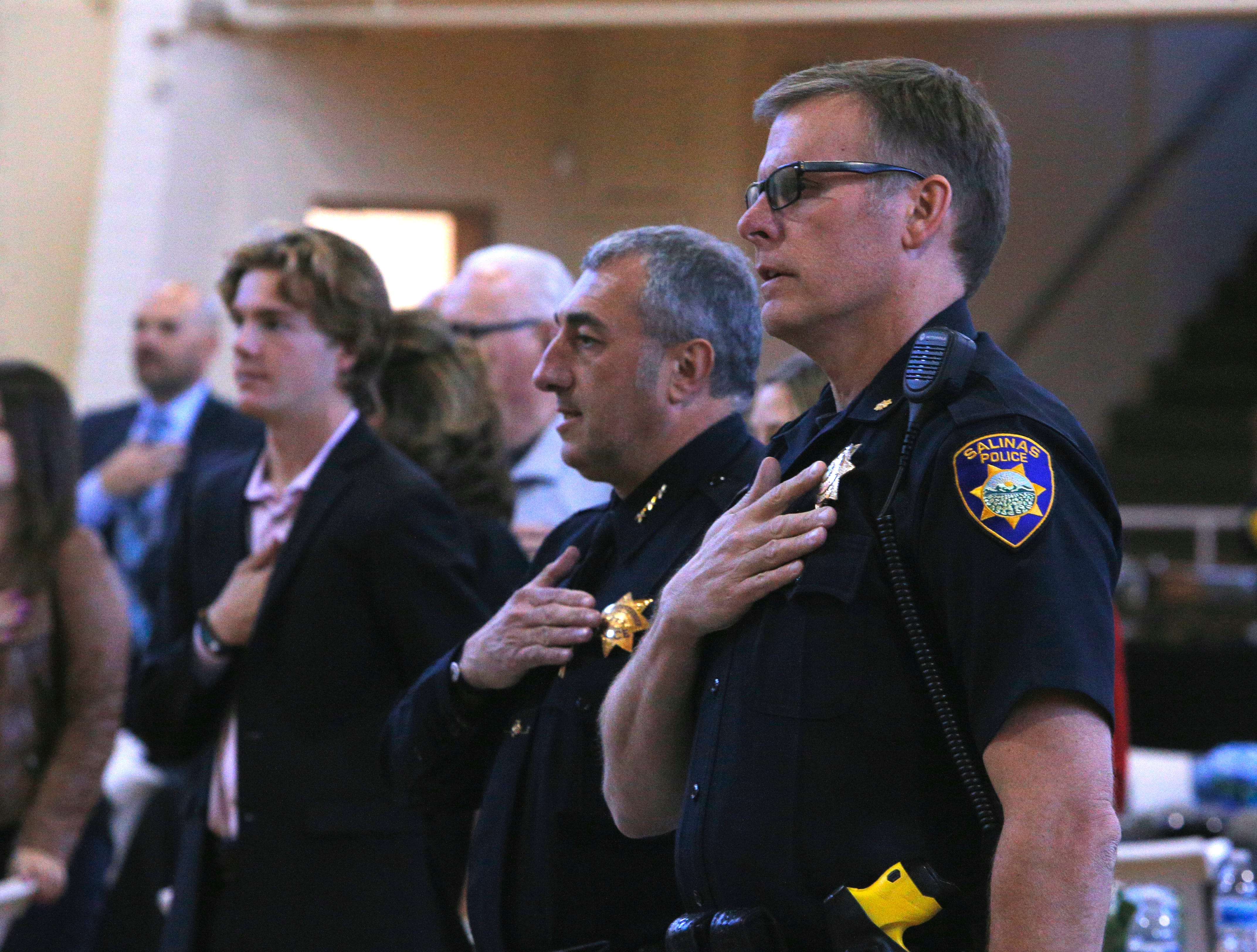 Cmdr. Vince Maiorana and others recite the Pledge of Allegiance March 14, 2019, at the Salinas Police Department's 2018 awards ceremony.