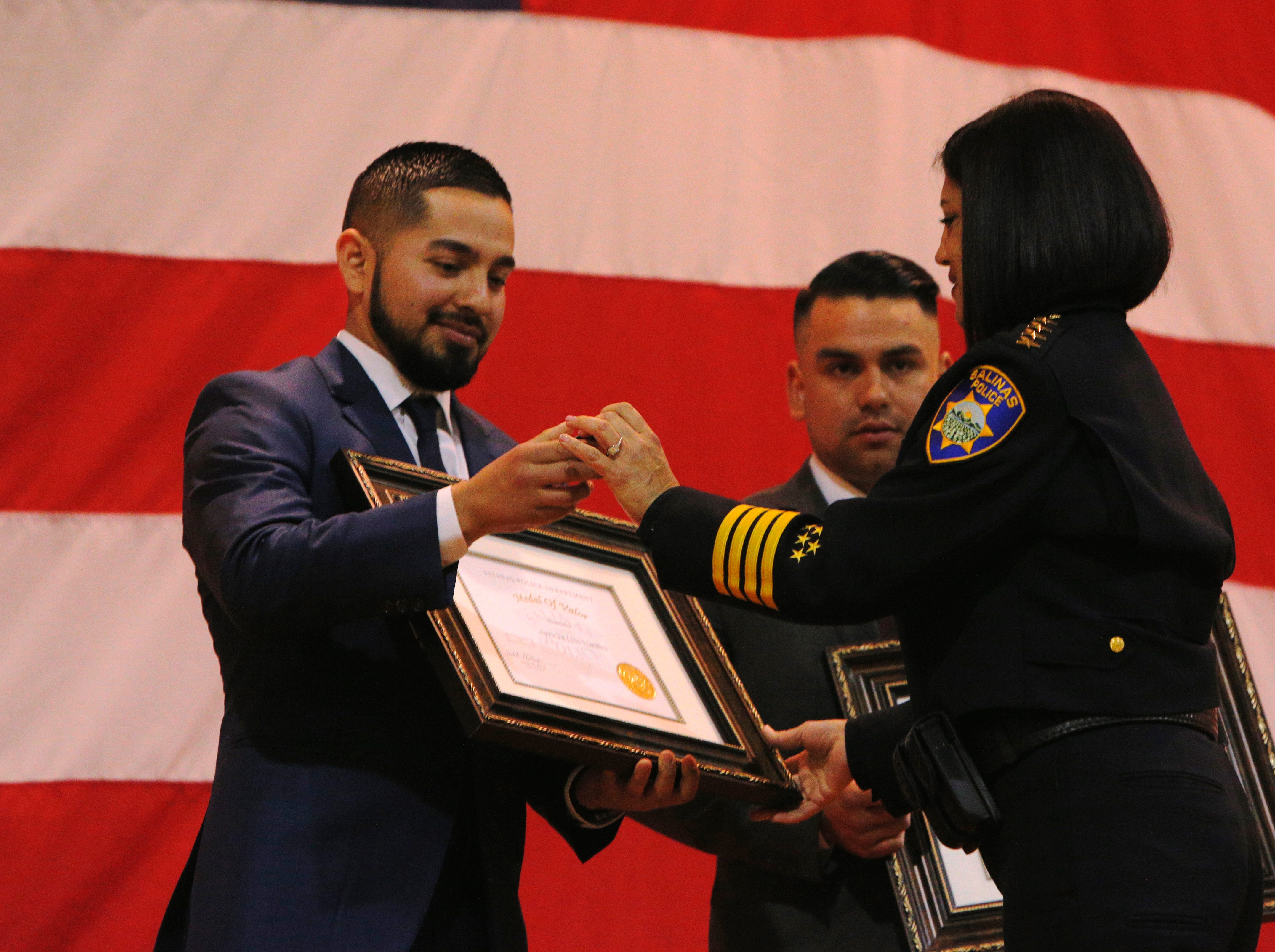 Salinas Police Chief Adele Fresé hands Officer Luis Toribio his commendation for earning the medal of valor March 14, 2019, at the Salinas Police Department's 2018 awards ceremony.