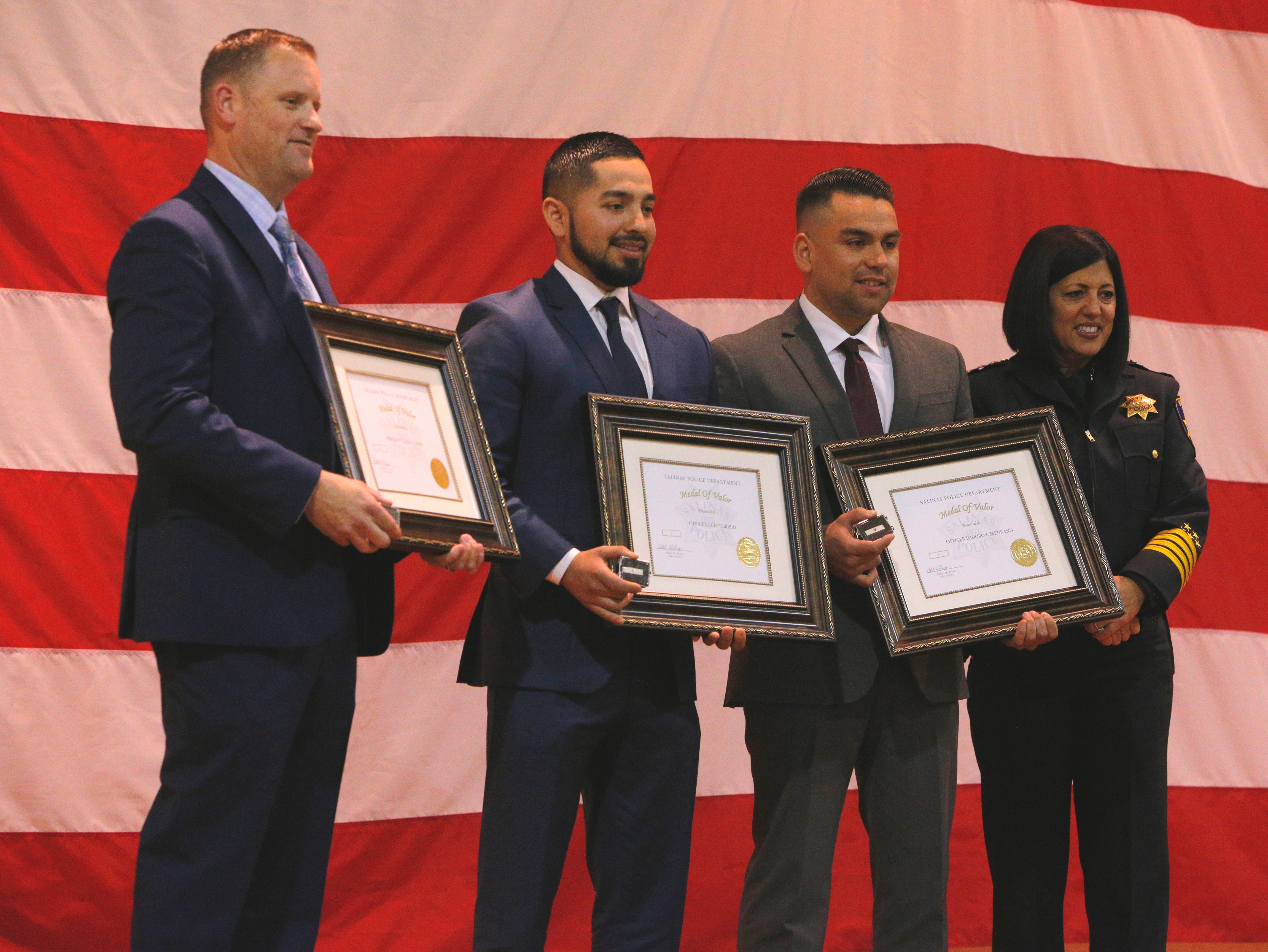 (From left): Sgt. Dale Fors, Officer Luis Toribio and Officer Isidoro Medrano pose with their awards alongside police chief Adele Fresé March 14, 2019, at the Salinas Police Department's 2018 awards ceremony.
