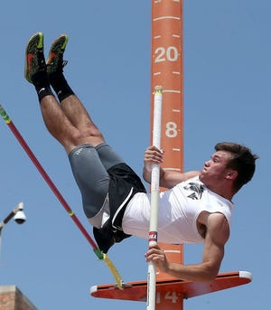 Water Valley's Jancen Power clears 14 feet to win the Class 1A boys pole vault at the 2016 UIL state track meet.