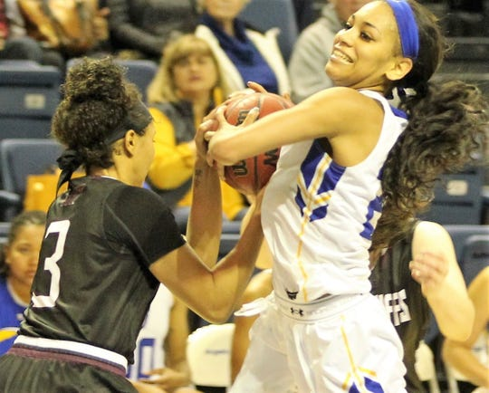 Angelo State University's Dezirae Hampton fights for the ball in a game earlier in the 2018-19 basketball season.
