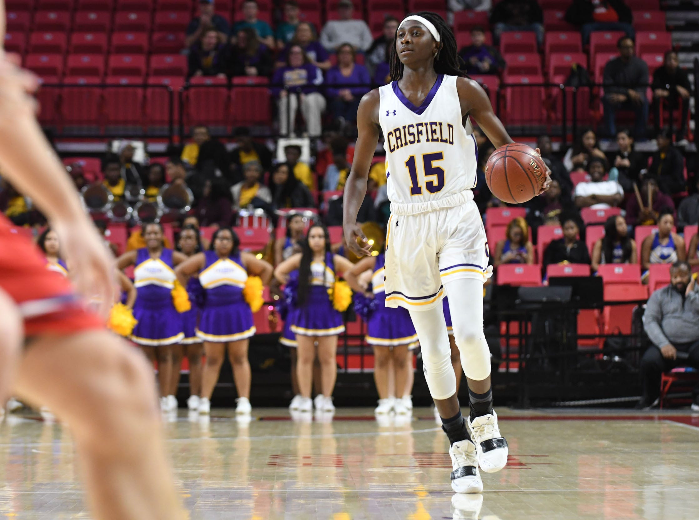 Crisfield's Cortrey Fontaine brings the ball down the court against Southern-Garrett during the MPSSAA State Championships at the Xfinity Center in College Park, Md. on Friday, March 15, 2019.