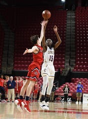 Crisfield's Cortrey Fontaine with the shot against Southern-Garrett during the MPSSAA State Championships at the Xfinity Center in College Park, Md. on Friday, March 15, 2019.