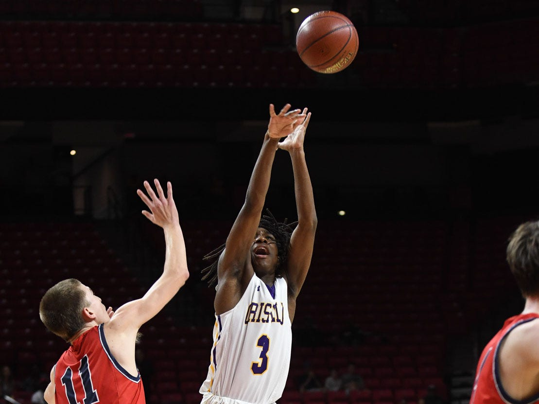 Crisfield's Rykell Waters with the shot against Southern-Garrett during the MPSSAA State Championships at the Xfinity Center in College Park, Md. on Friday, March 15, 2019.