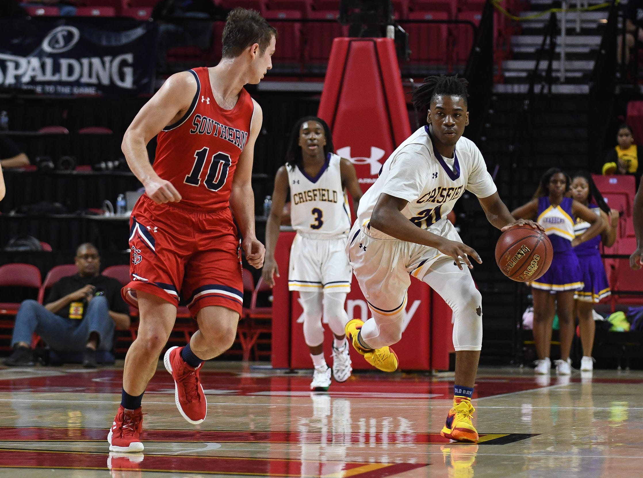 Crisfield's Christian Crawford with the take away against Southern-Garrett during the MPSSAA State Championships at the Xfinity Center in College Park, Md. on Friday, March 15, 2019.