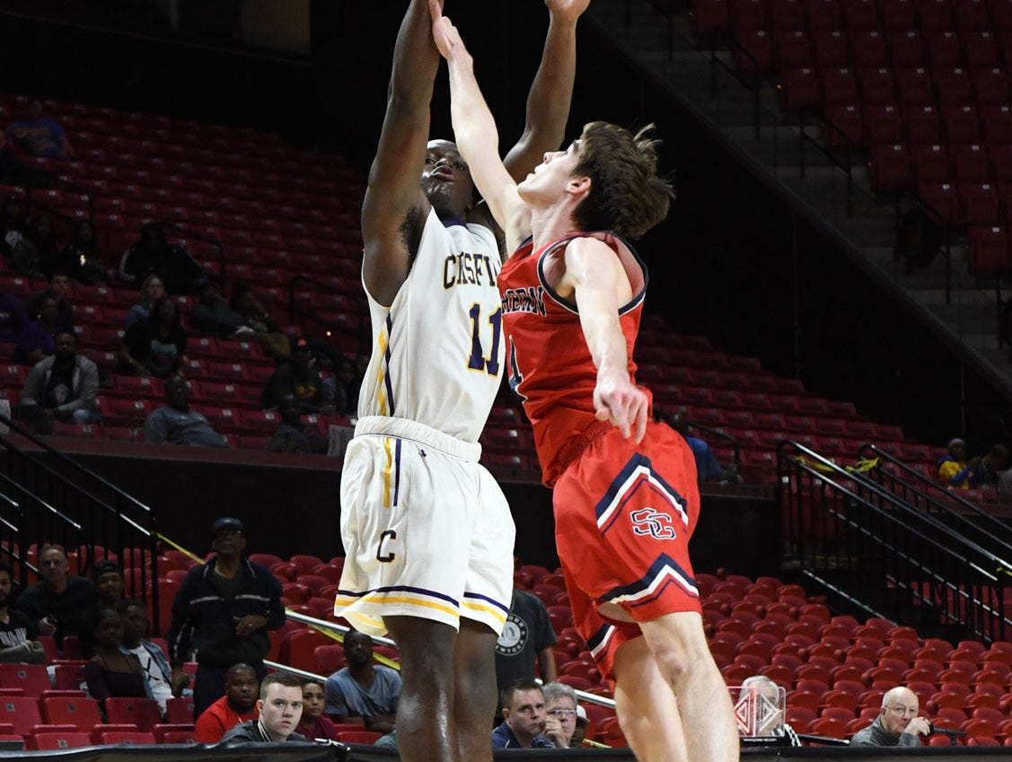 Crisfield's Justin Cohen with the shot against Southern-Garrett during the MPSSAA State Championships at the Xfinity Center in College Park, Md. on Friday, March 15, 2019.