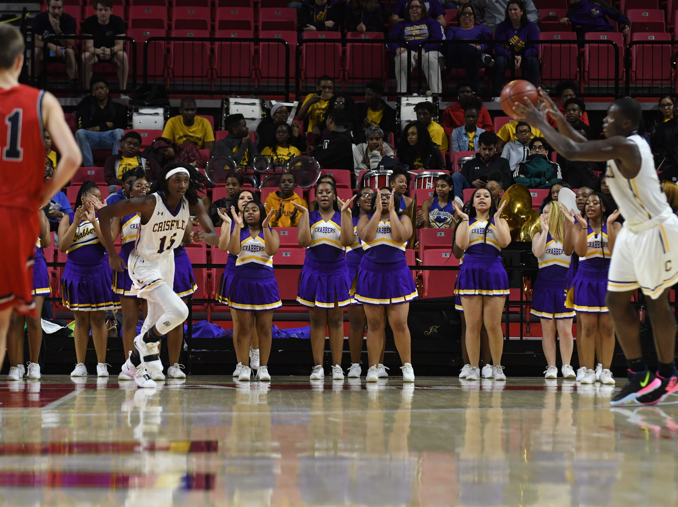 Crisfield's Cheerleaders pep up the team against Southern-Garrett during the MPSSAA State Championships at the Xfinity Center in College Park, Md. on Friday, March 15, 2019.