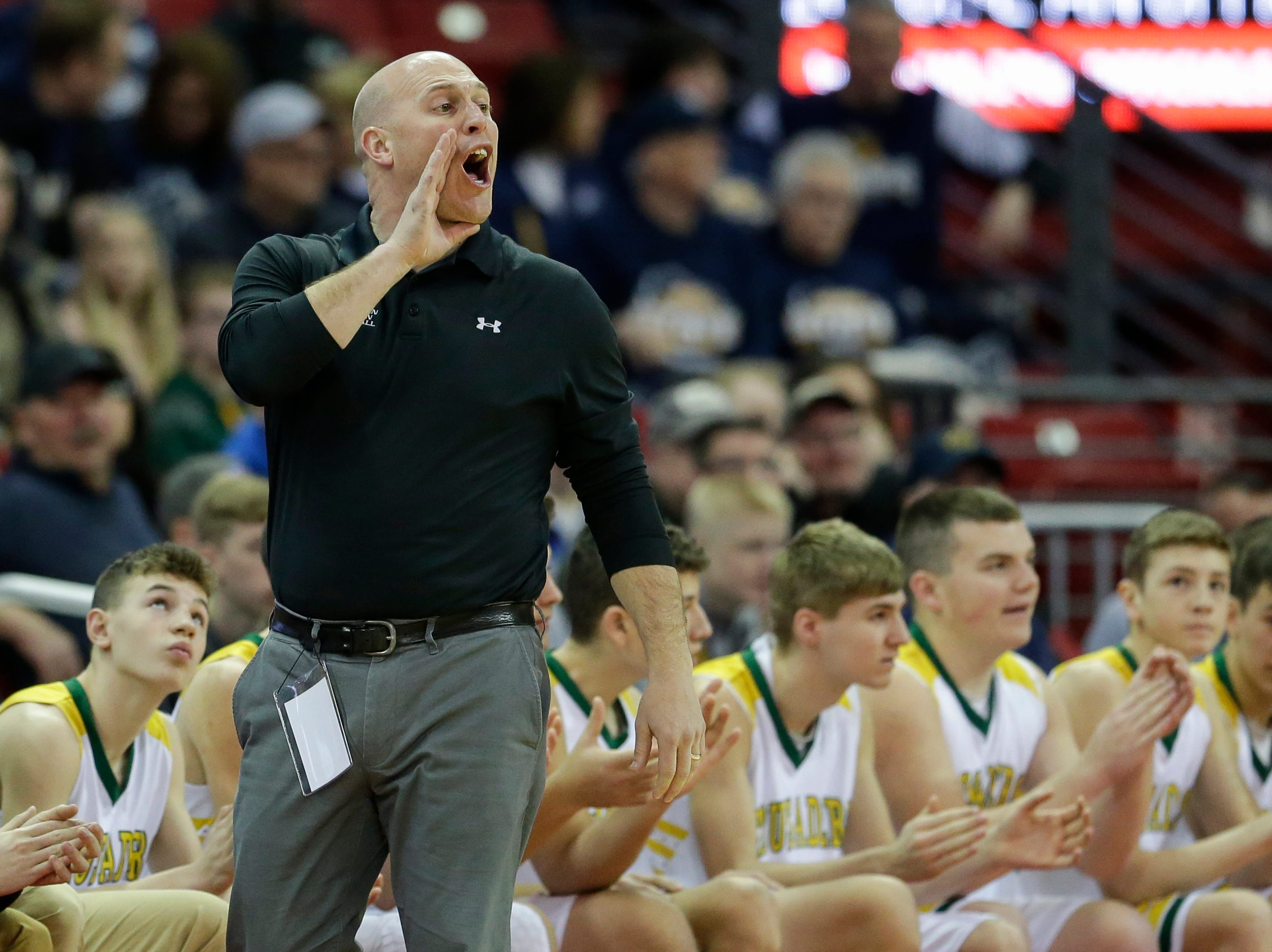 Sheboygan Area Lutheran High School's Nick Verhagen calls out a play on the sideline as they play McDonell Central Catholic High School during their WIAA Division 5 boys basketball state semifinal at the Kohl Center Friday, March 15, 2019, in Madison, Wis.
