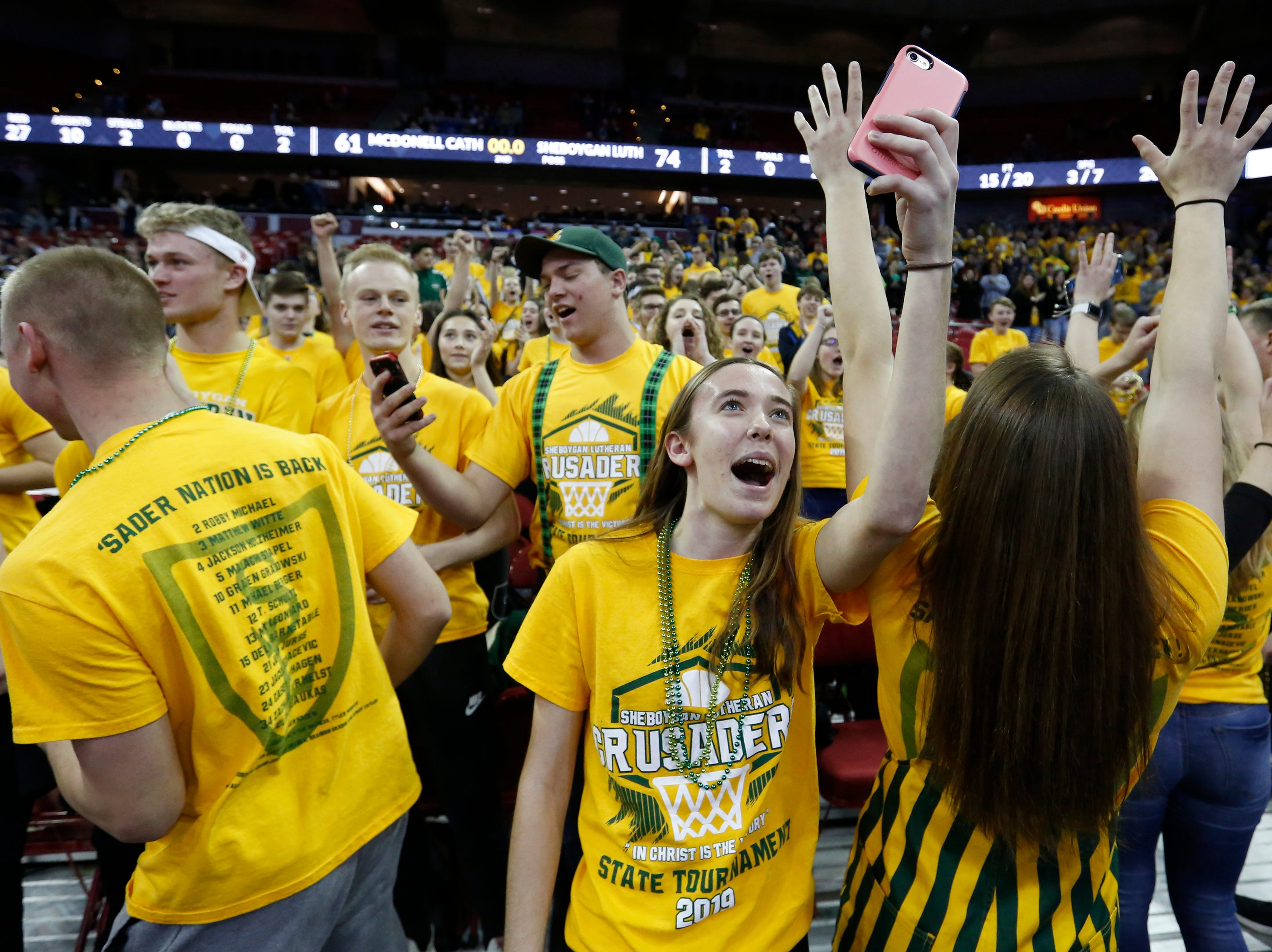 Sheboygan Area Lutheran High School's student section reacts after the Crusaders defeat McDonell Central Catholic High School in their WIAA Division 5 boys basketball state semifinal at the Kohl Center Friday, March 15, 2019, in Madison, Wis. The Crusaders defeated the Macks 74-61.