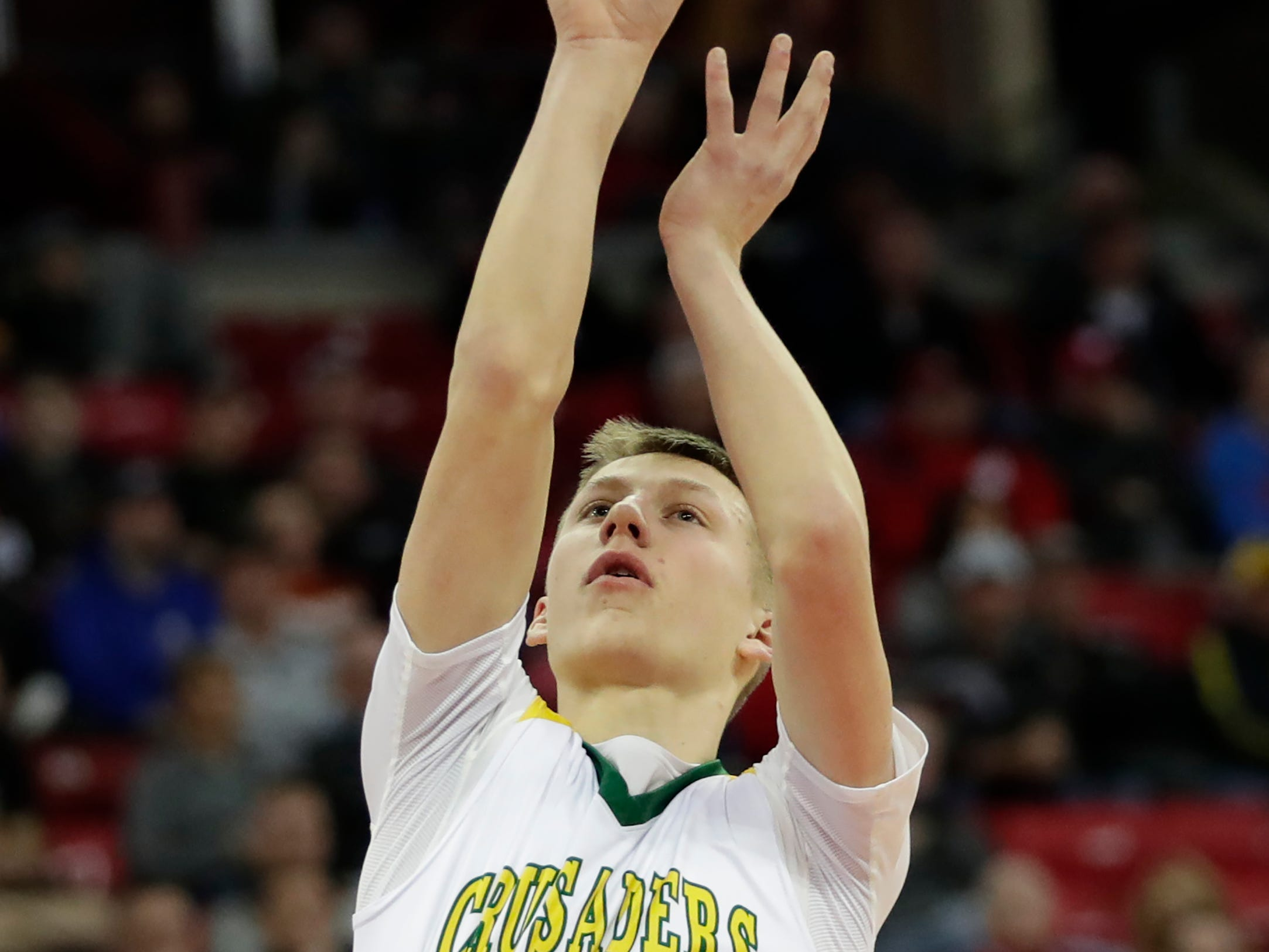 Sheboygan Area Lutheran High School's Casey Verhagen (24) puts up a shot against McDonell Central Catholic High School during their WIAA Division 5 boys basketball state semifinal at the Kohl Center Friday, March 15, 2019, in Madison, Wis.
