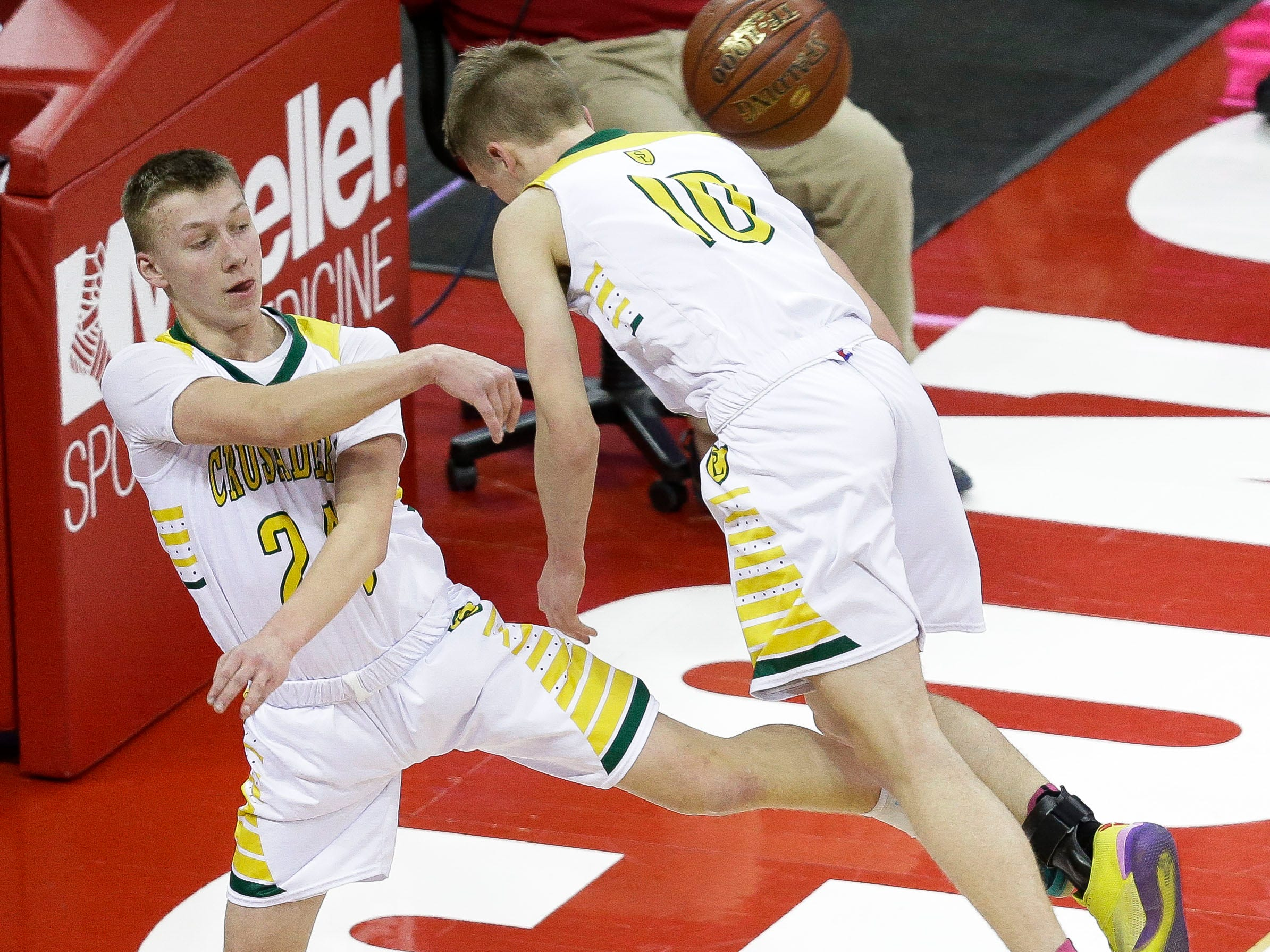 Sheboygan Lutheran High School's Casey Verhagen (24) tries to save a ball under the basket against McDonell Central Catholic High School in a Division 5 boys basketball state semifinal on Friday, March 15, 2019, at the Kohl Center in Madison, Wis.