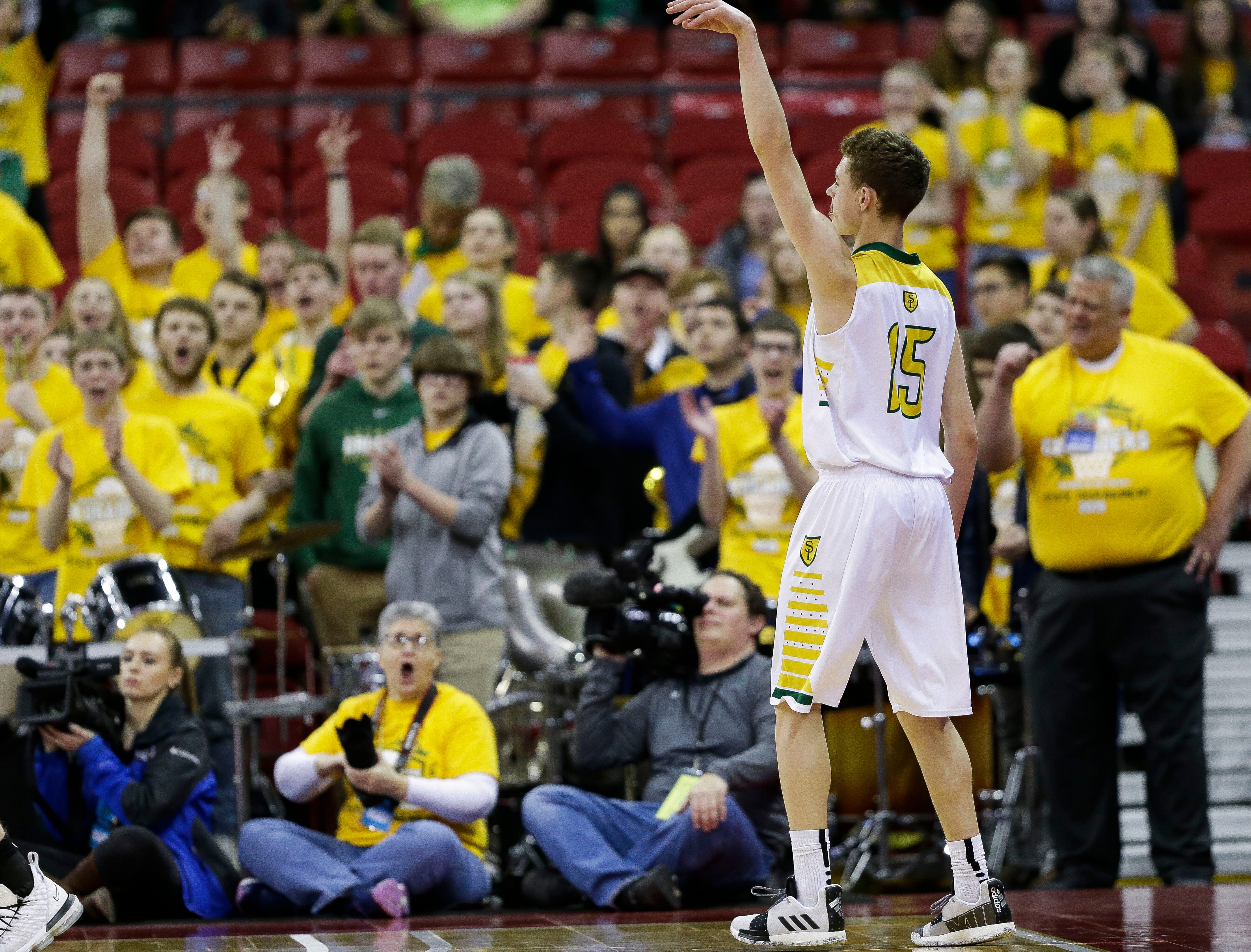 Sheboygan Lutheran High School's Delvin Barnstable (15) holds his finish after hitting a 3-pointer against McDonell Central Catholic High School in a Division 5 boys basketball state semifinal on Friday, March 15, 2019, at the Kohl Center in Madison, Wis.