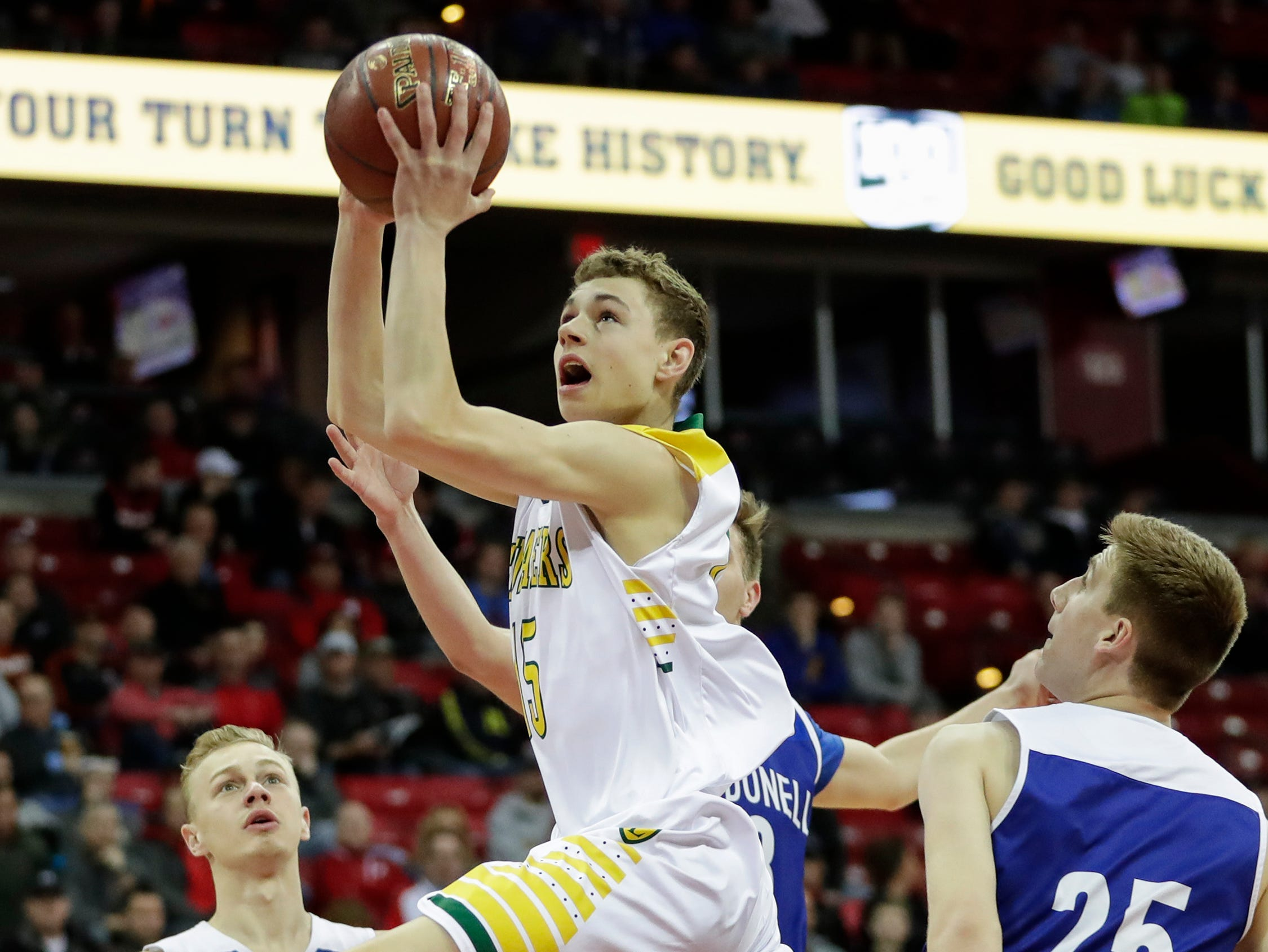Sheboygan Area Lutheran High School's Delvin Barnstable (15) drives to the basket against McDonell Central Catholic High School during their WIAA Division 5 boys basketball state semifinal at the Kohl Center Friday, March 15, 2019, in Madison, Wis.