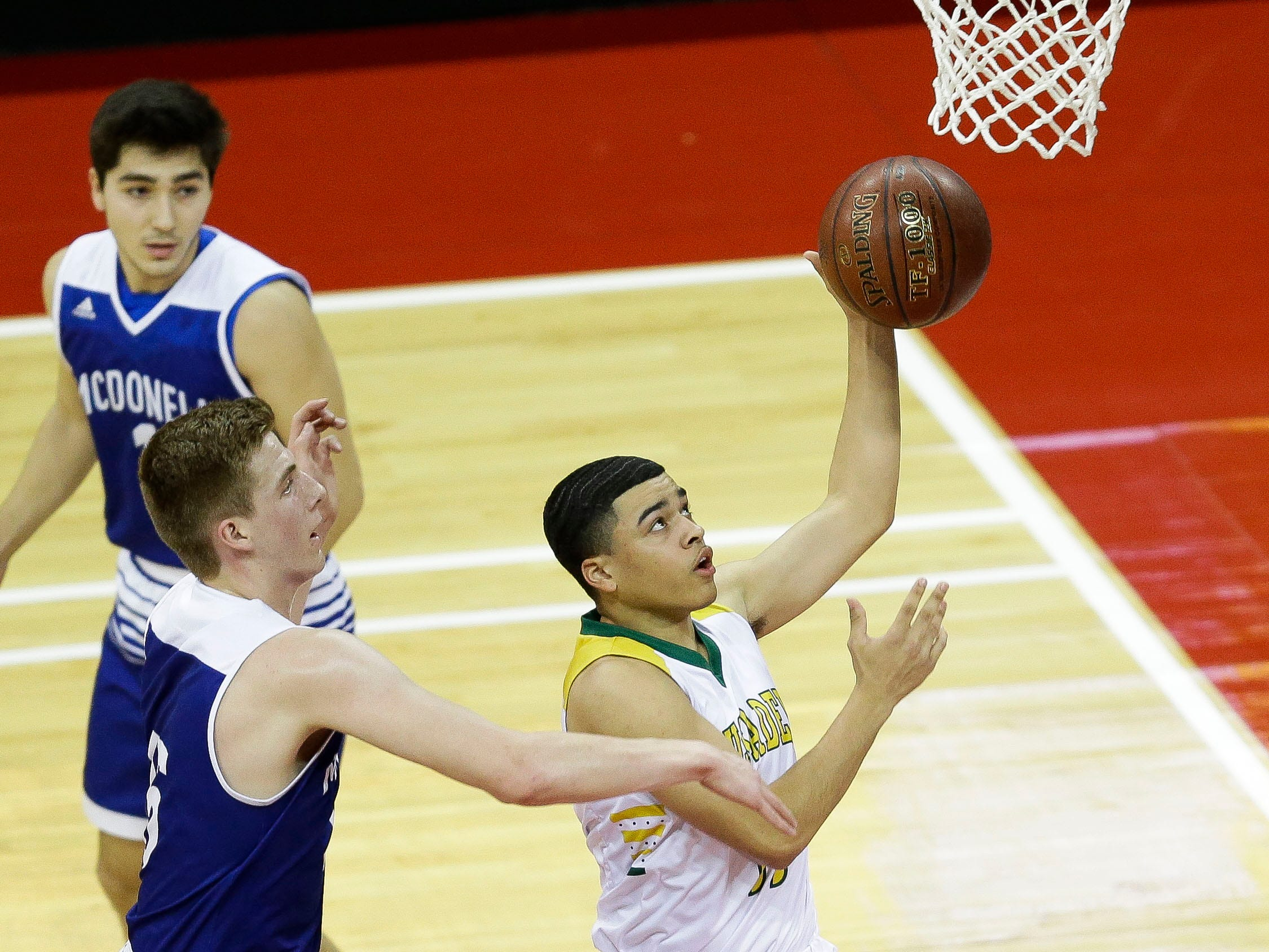 Sheboygan Lutheran High School's Michael Berger (11) goes up for a layup against McDonell Central Catholic High School in a Division 5 boys basketball state semifinal on Friday, March 15, 2019, at the Kohl Center in Madison, Wis.
