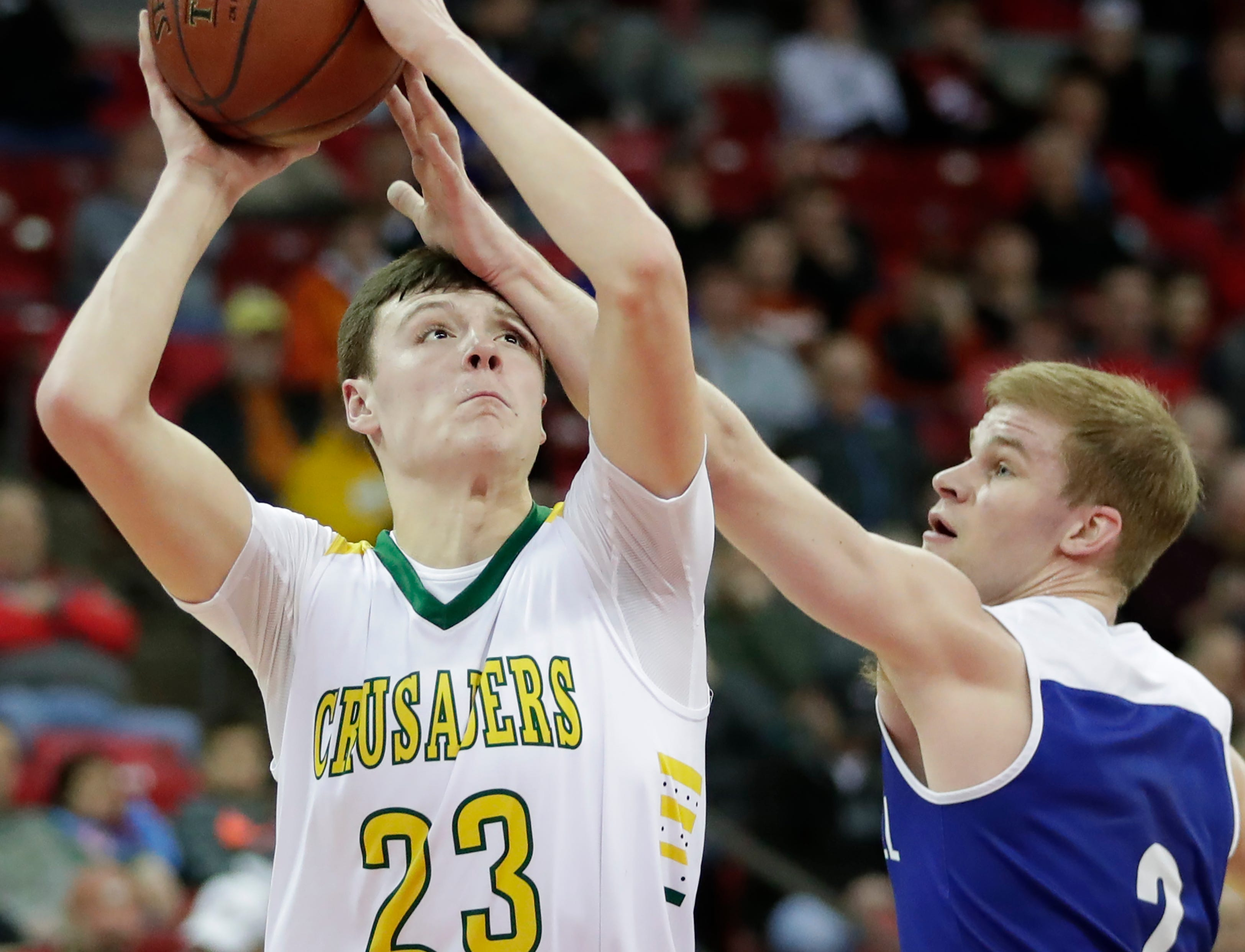 Sheboygan Area Lutheran High School's Jacob Ognacevic (23) looks to shoots against McDonell Central Catholic High School's Cory Hoglund (2) during their WIAA Division 5 boys basketball state semifinal at the Kohl Center Friday, March 15, 2019, in Madison, Wis.