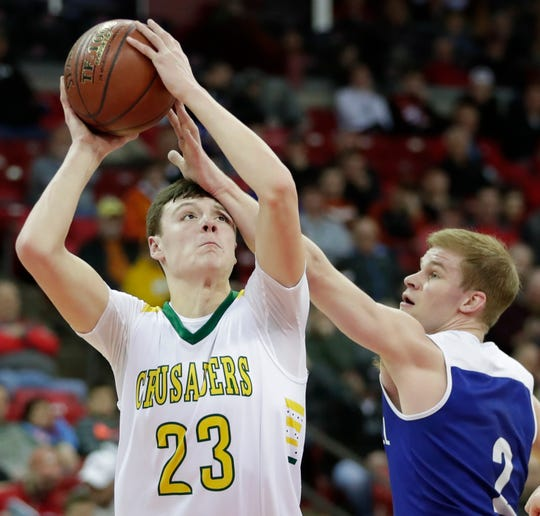 Sheboygan Lutheran's Jacob Ognacevic (23) looks to shoots against McDonell Central Catholic's Cory Hoglund during their WIAA Division 5 boys basketball state semifinal at the Kohl Center on March 15.