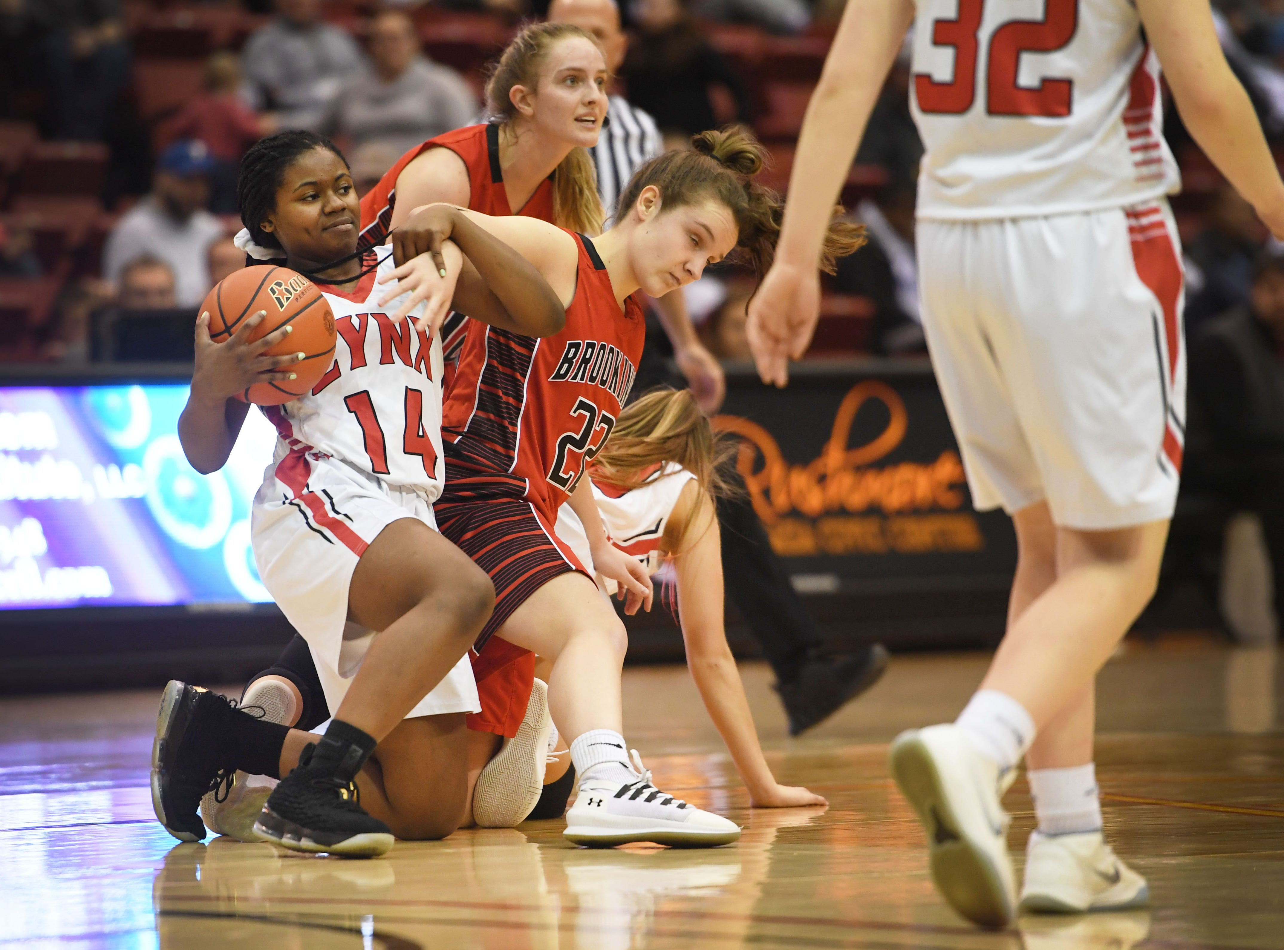 Brandon Valley's India Bradfield goes against Brookings defense during the game in the Class AA quarterfinals Thursday, March 14, in Rapid City.