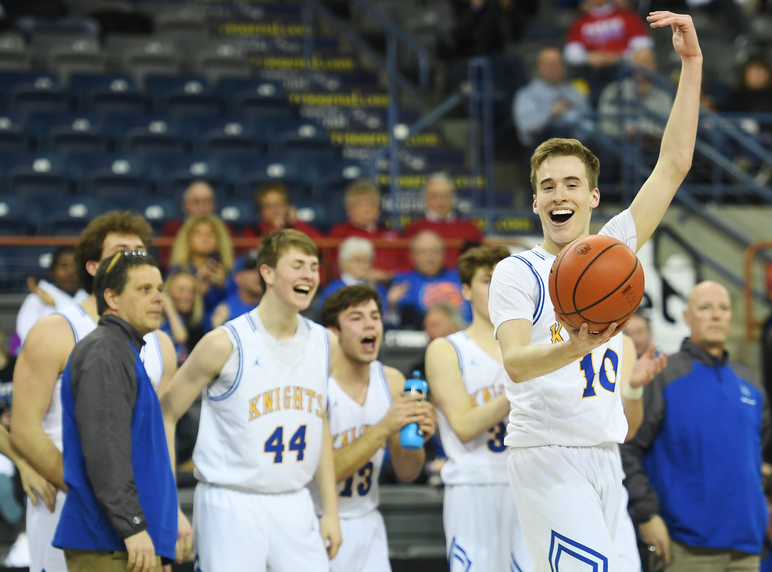 O'Gorman's Jack Cartwright motions to the crowd in the last seconds of the game against Roosevelt in the Class AA quarterfinals Thursday, March 14, in Rapid City.