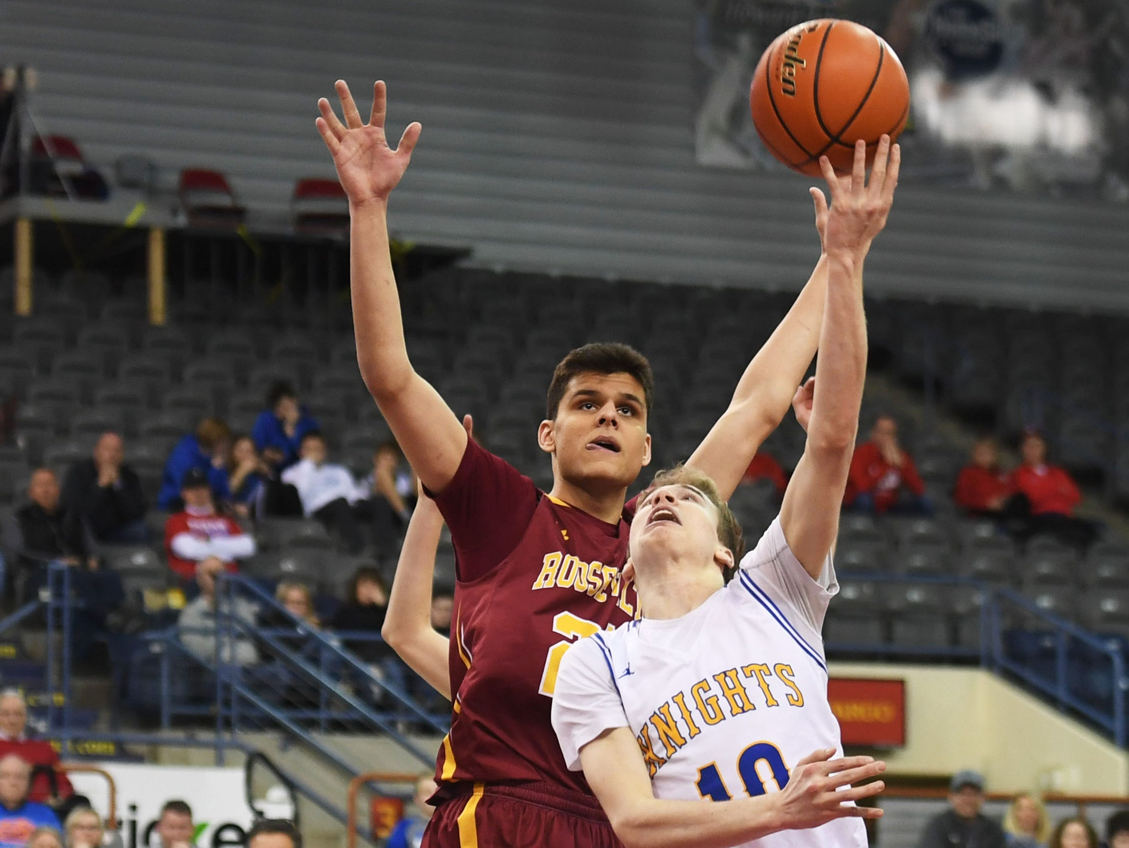 O'Gorman's Jack Cartwright takes a shot during the game against Roosevelt in the Class AA quarterfinals Thursday, March 14, in Rapid City.