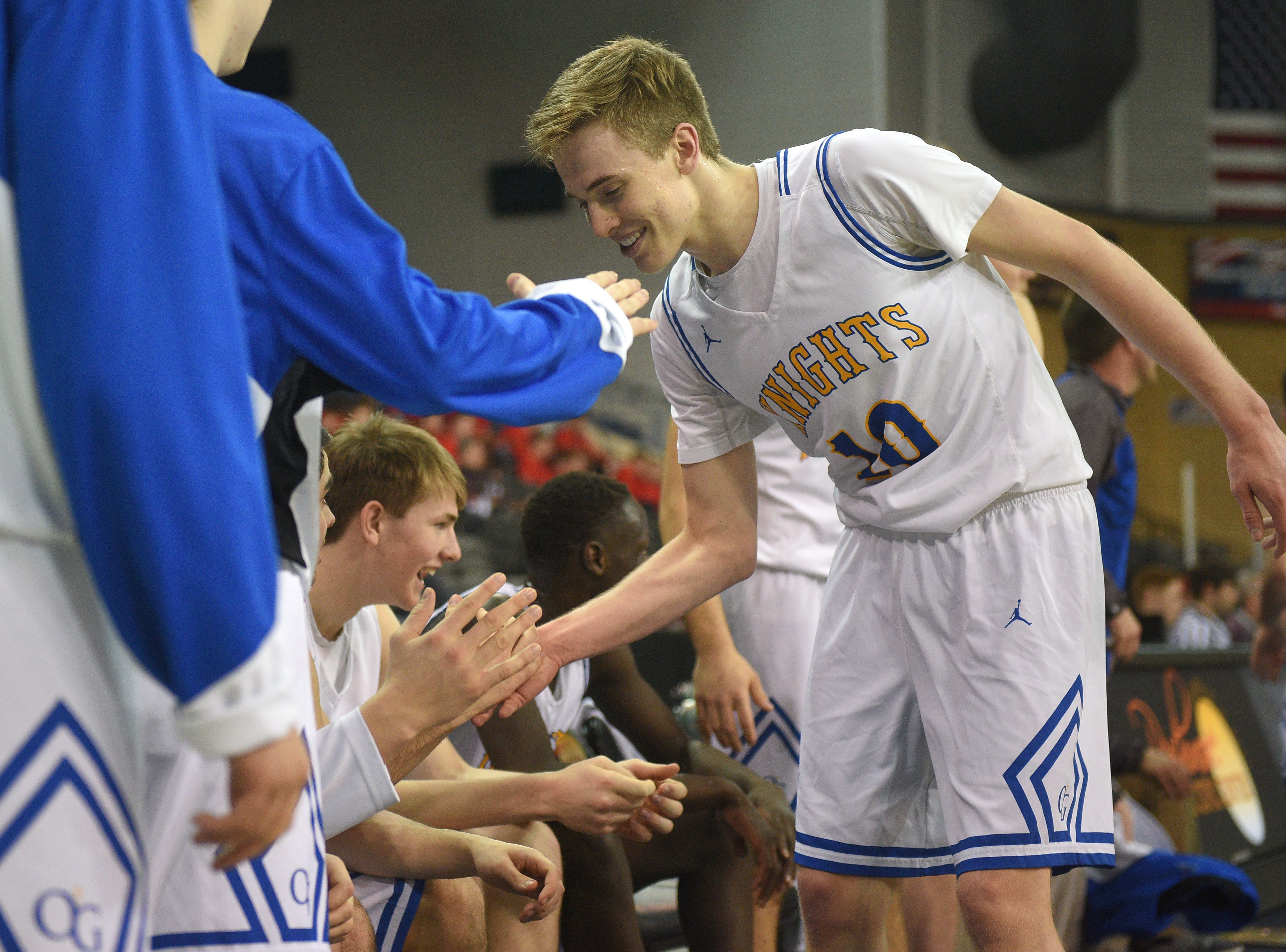 O'Gorman's Jack Cartwright high fives his teammates in the last seconds of the game against Roosevelt in the Class AA quarterfinals Thursday, March 14, in Rapid City.
