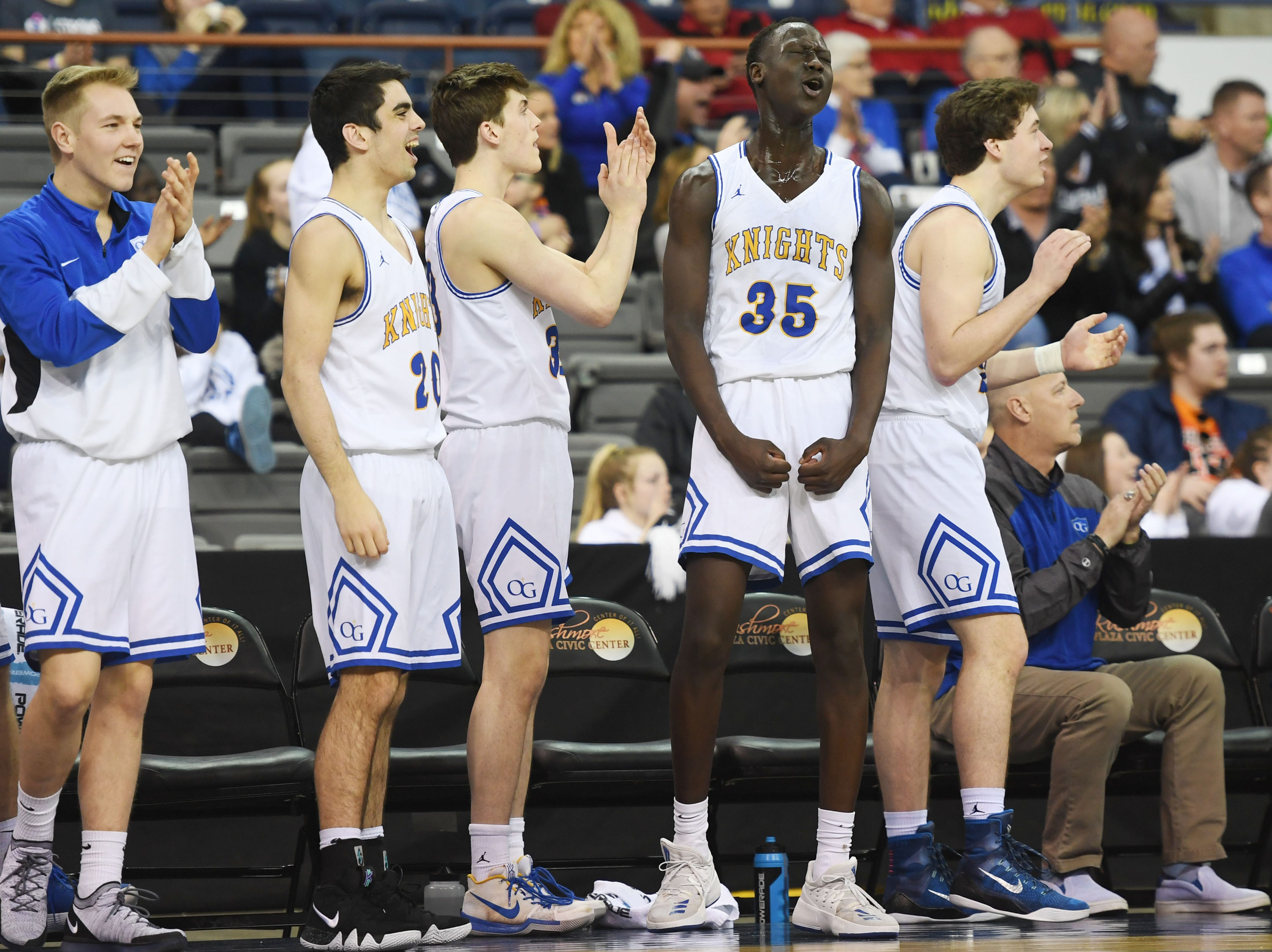 O'Gorman's Akoi Akoi (35) celebrates on the sidelines during the game game against Roosevelt in the Class AA quarterfinals Thursday, March 14, in Rapid City.