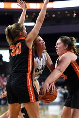 West Central's Megan Madsen, center, is tied up by Lennox duo Leslie Fillipi, right, and Rianna Fillipi during their semifinal game at the State A Girls Basketball Tournament on Friday in Sioux Falls.