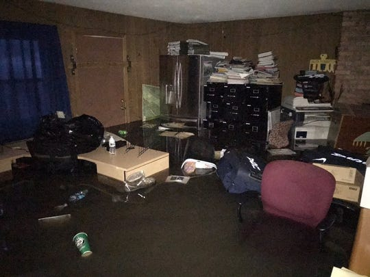 Inside an office at Leif Ericson YMCA camp in Sioux Falls, after Big Sioux River flooding.