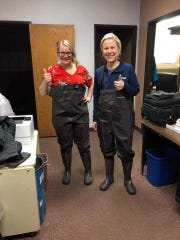 KDLT News Director Anndrea Anderson (left) and General Manager Katie Haffeman bought waders at Scheels to reach the TV station's office on Westport Avenue.