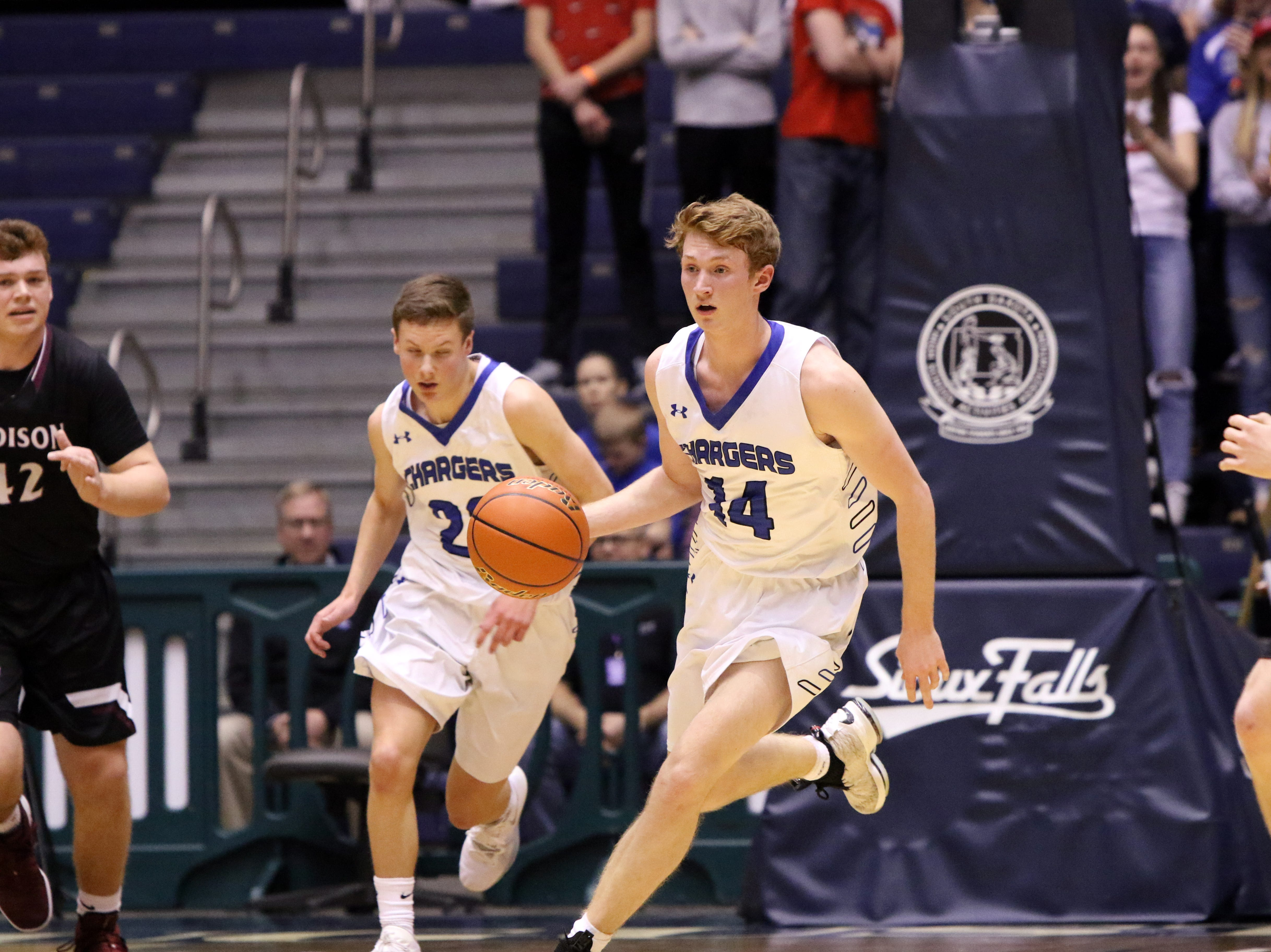 Gavin Schipper of Sioux Falls Christian leads a fast break against Madison during Thursday's game at the Arena in Sioux Falls.