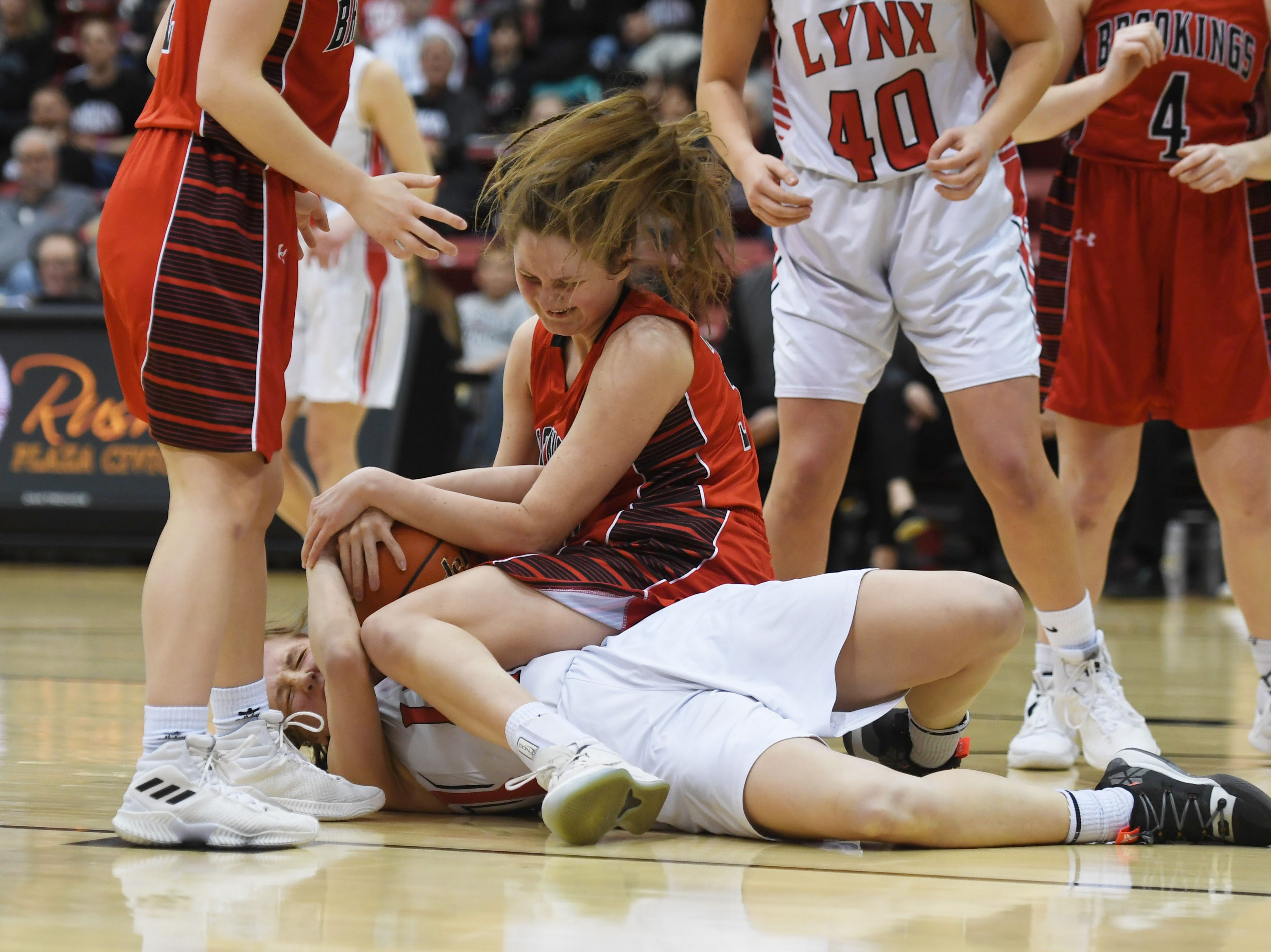 Brookings' Michaela Jewett and Brandon Valley's Ashley Wells attempt to gain control of the ball in the Class AA quarterfinals Thursday, March 14, in Rapid City.