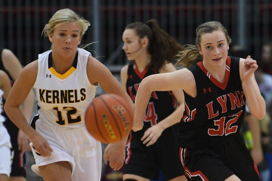 Mitchell's Avia Haley goes against Brandon Valley's Danica Kocer during the game in the Class AA semifinals Thursday, March 15, in Rapid City.