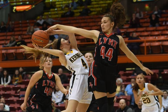 Mitchell's Tess Limberg goes against Brandon Valley's Trinity Law under the net during the game in the Class AA semifinals Thursday, March 15, in Rapid City.
