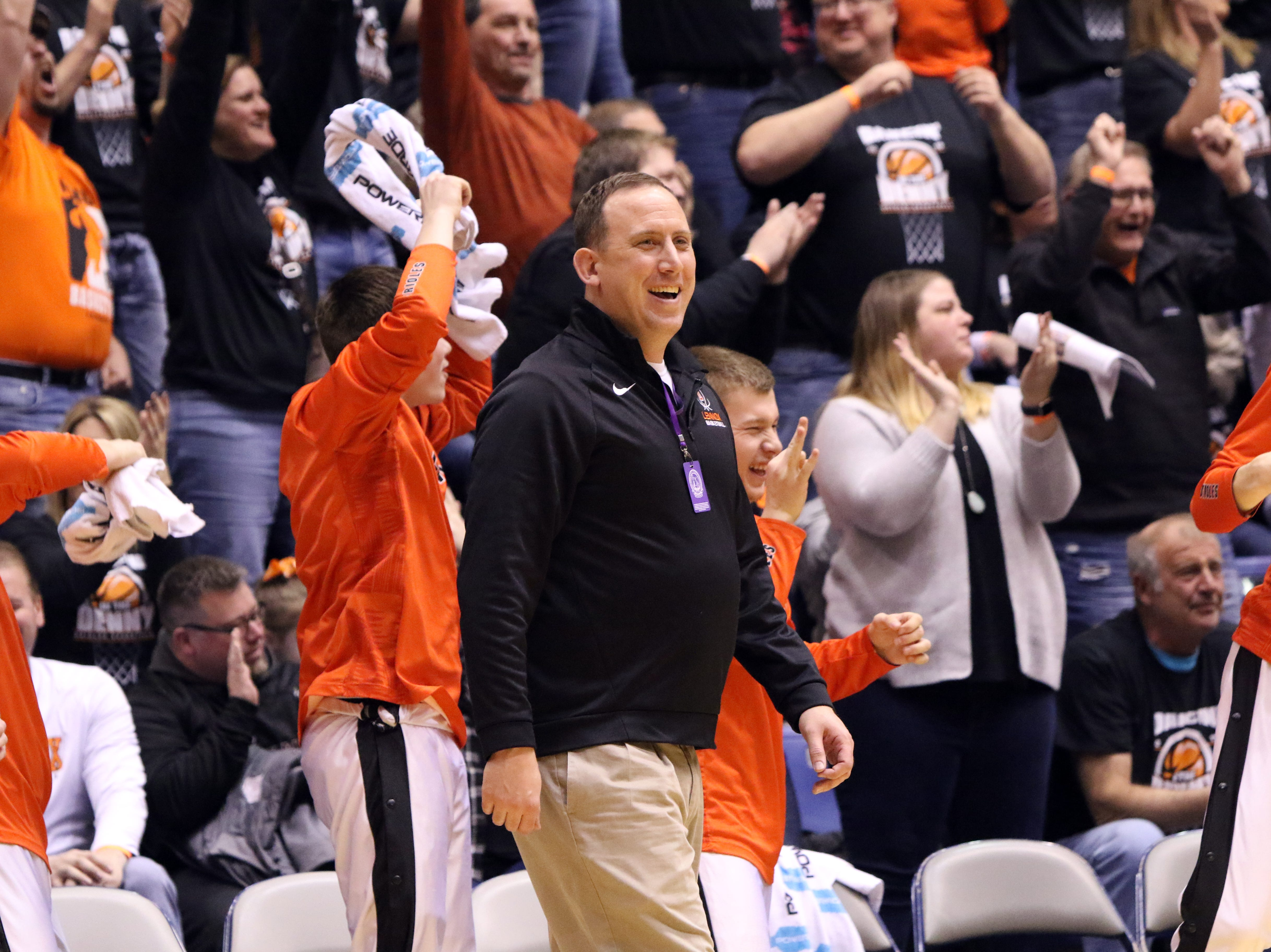 Lennox Head Coach, Paul McVey smiles after his team scores a basket against St Thomas More on Thursday at the Arena in Sioux Falls.