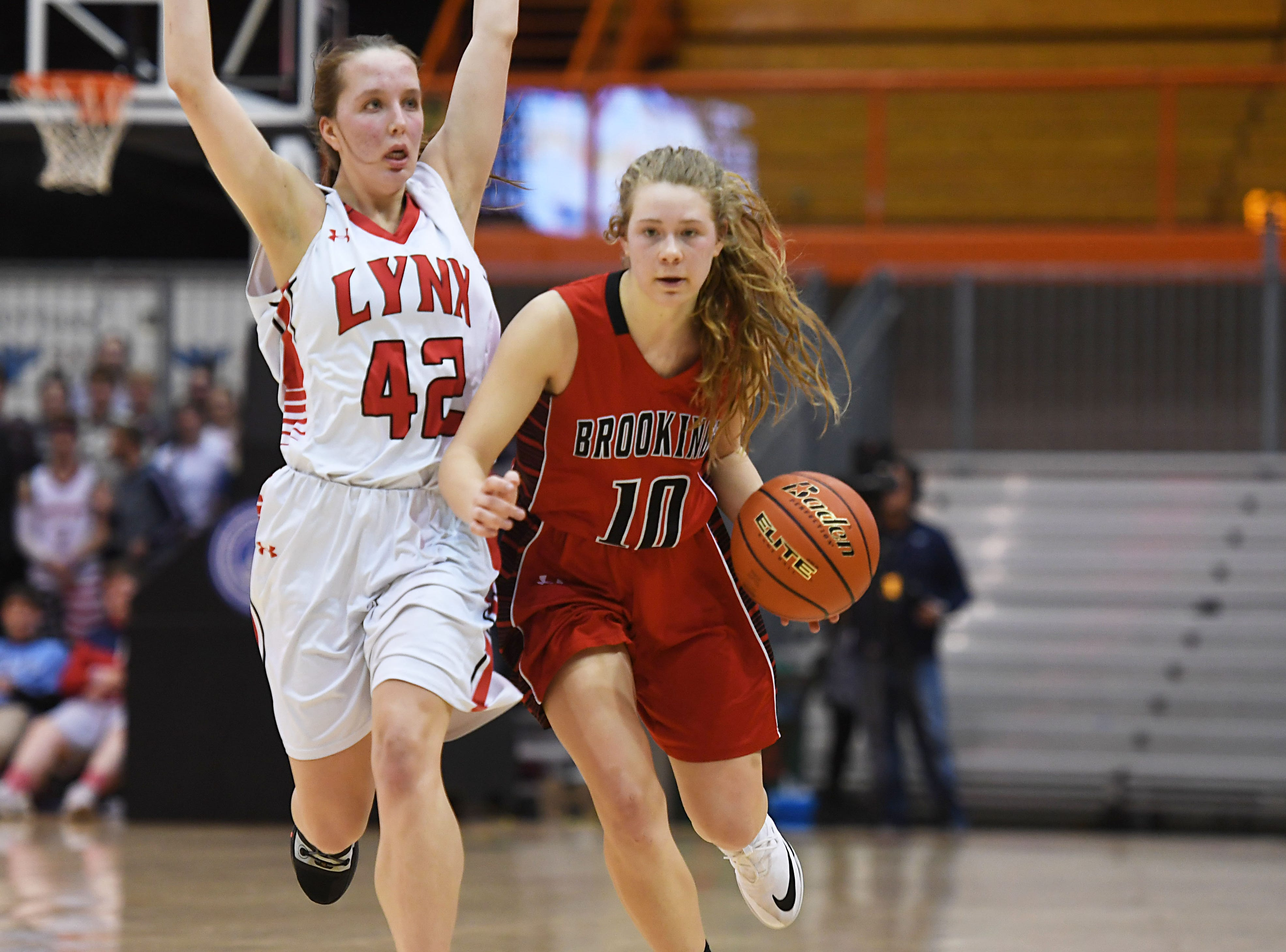 Brookings's Regan Weisbeck goes against Brandon Valley's Ashley Wells in the Class AA quarterfinals Thursday, March 14, in Rapid City.