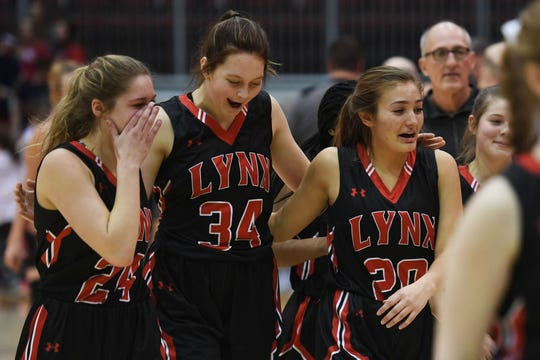 Brandon Valley's Emma Jarovski, from left, Olivia Klumper and Mara Schaap celebrate their win against Mitchell in the Class AA semifinals Thursday, March 15, in Rapid City.