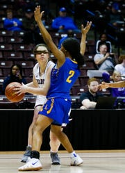 The hair of Logan-Rogersville's Sydney Dunavant blocks her eyes for a brief moment as she looks for a way around Lincoln College Prep's Ajanee Bradley during the Class 4 semifinal game at JQH Arena on Friday, March 15, 2019.