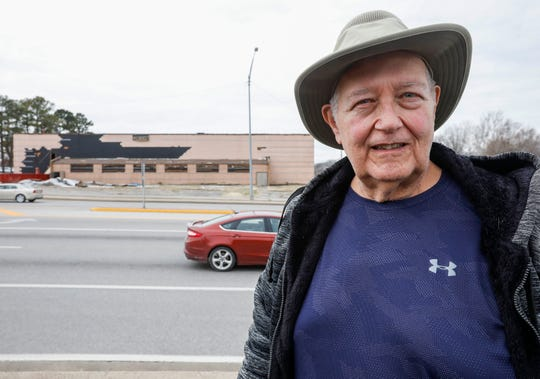 Darrell Hickman stands across the street from the O'Reilly gym on Glenstone Avenue.