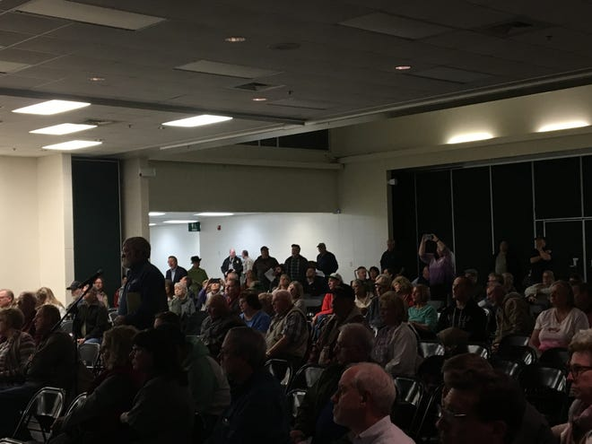Don York, a resident near the former Litton Systems industrial site, directed questions about TCE pollution in the area to a panel of state officials at a public forum held March 13, 2019.