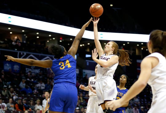 Logan-Rogersville's Jordyn Gault shoots a basket over Lincoln College Prep's Jasia Nicholson during the Class 4 semifinal game at JQH Arena on Friday, March 15, 2019.