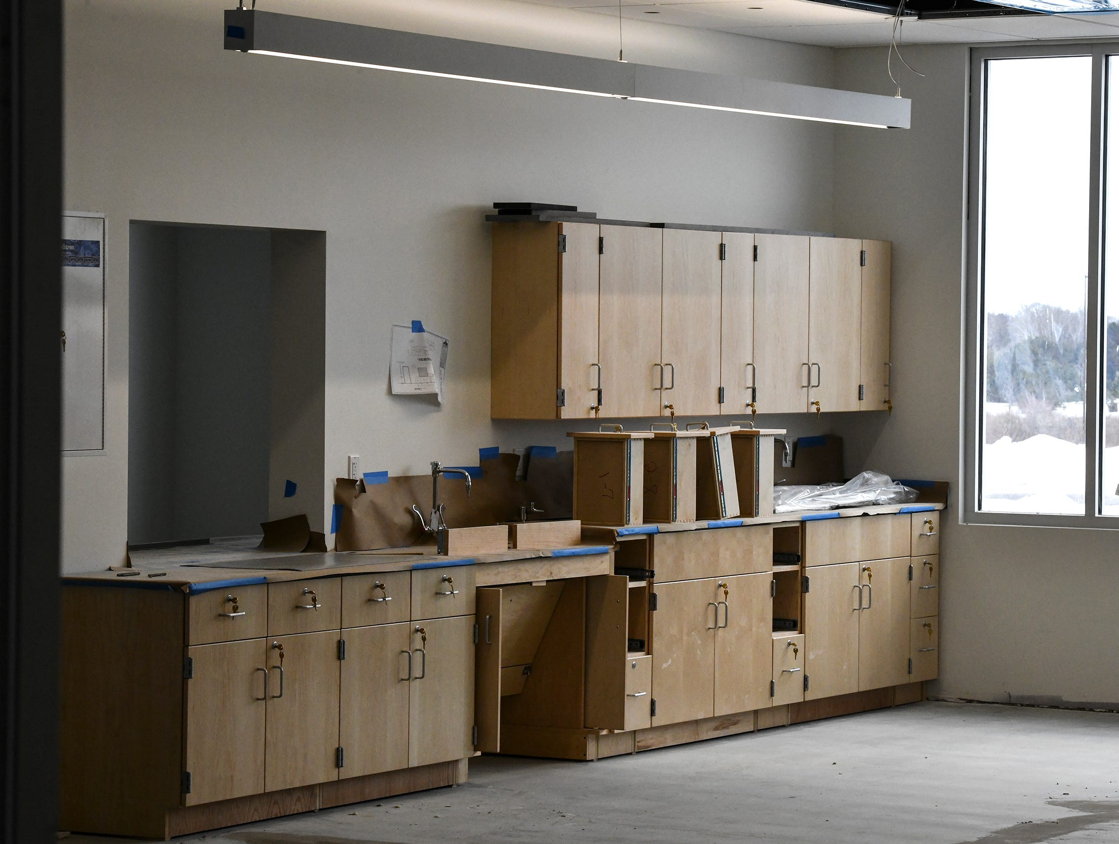 Cabinets are installed in a science classroom at the new Tech High School building Friday, March 15, in St. Cloud.