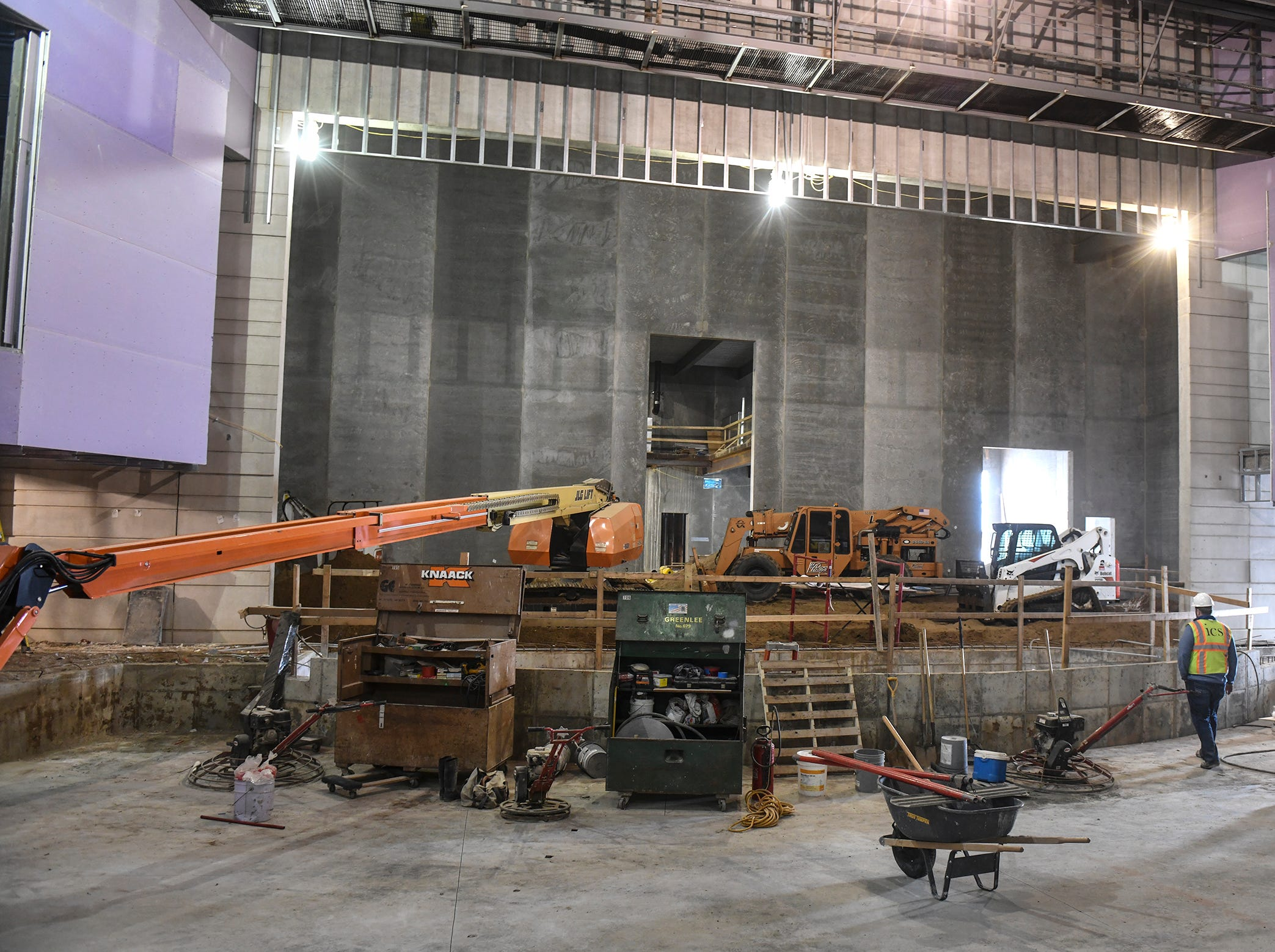 The stage and orchestra pit in the new auditorium are pictured during a tour of the new Tech High School building under construction Friday, March 15, in St. Cloud.