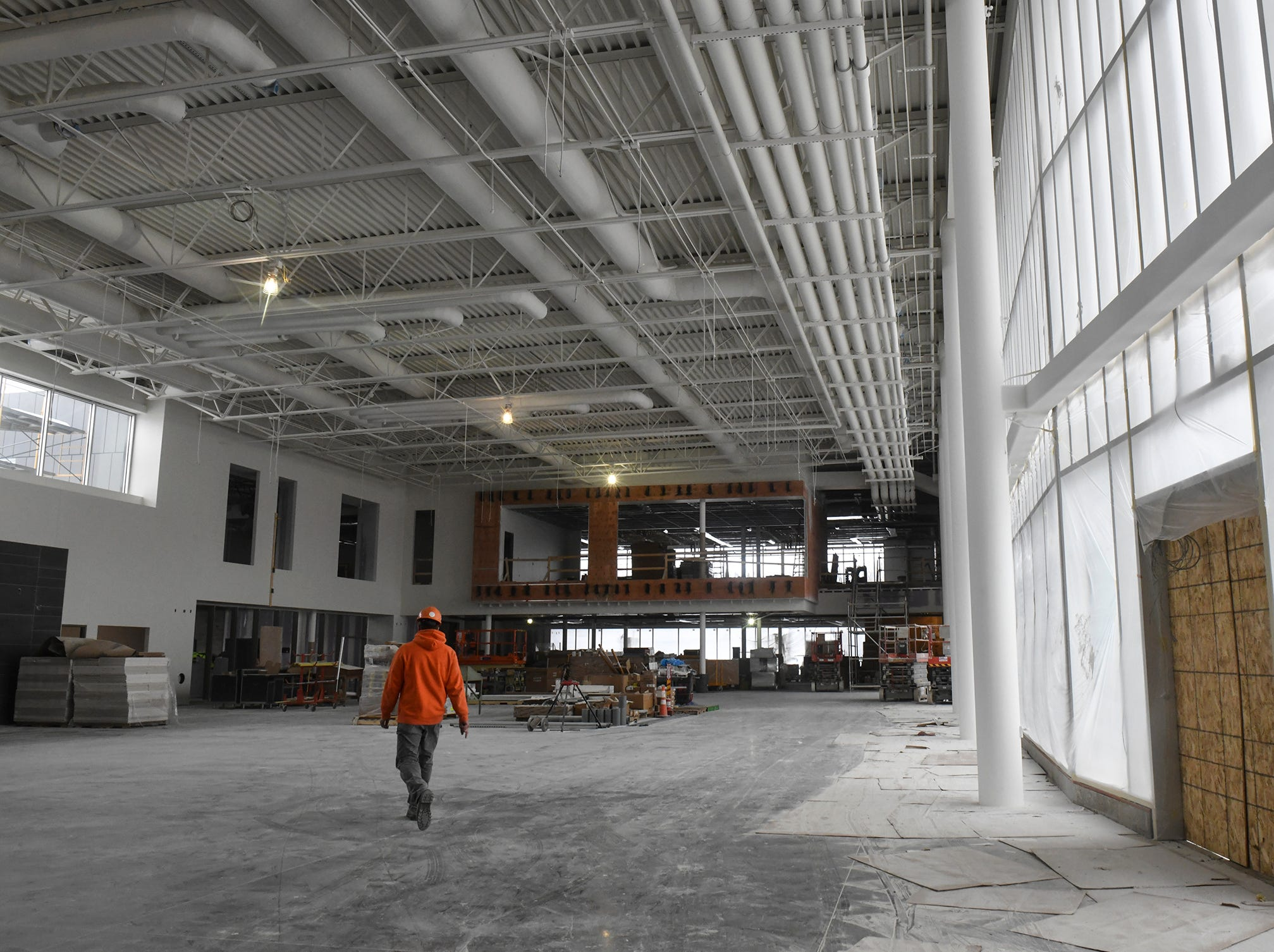 Large windows flood the commons area the new Tech High School building under construction Friday, March 15, in St. Cloud.