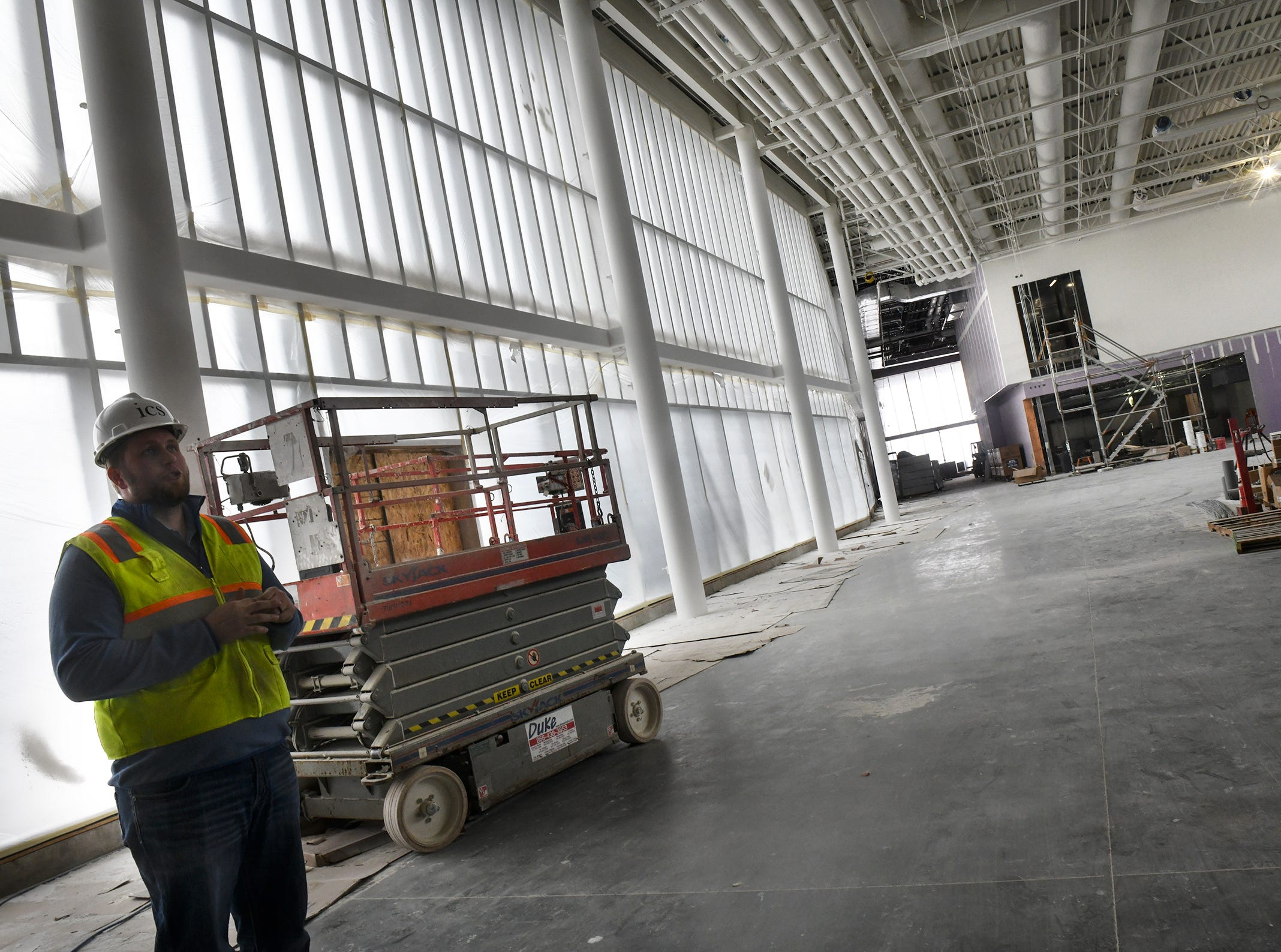 Site supervisor Kyle Walter talks about progress in construction during a tour of the new Tech High School building Friday, March 15, in St. Cloud.