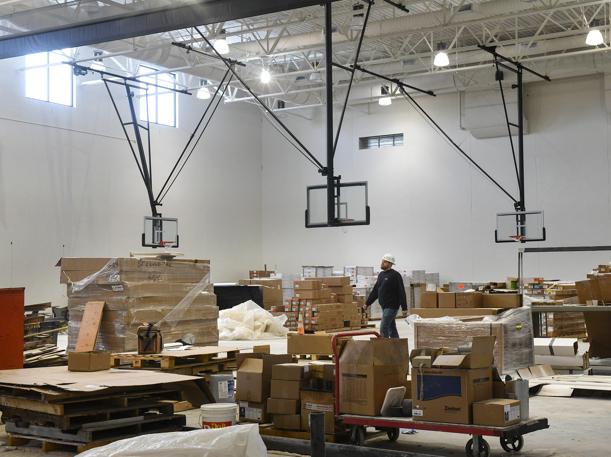The baskets are in place and materials are staged for installation in the new gymnasium at the Tech High School building under construction Friday, March 15, in St. Cloud.