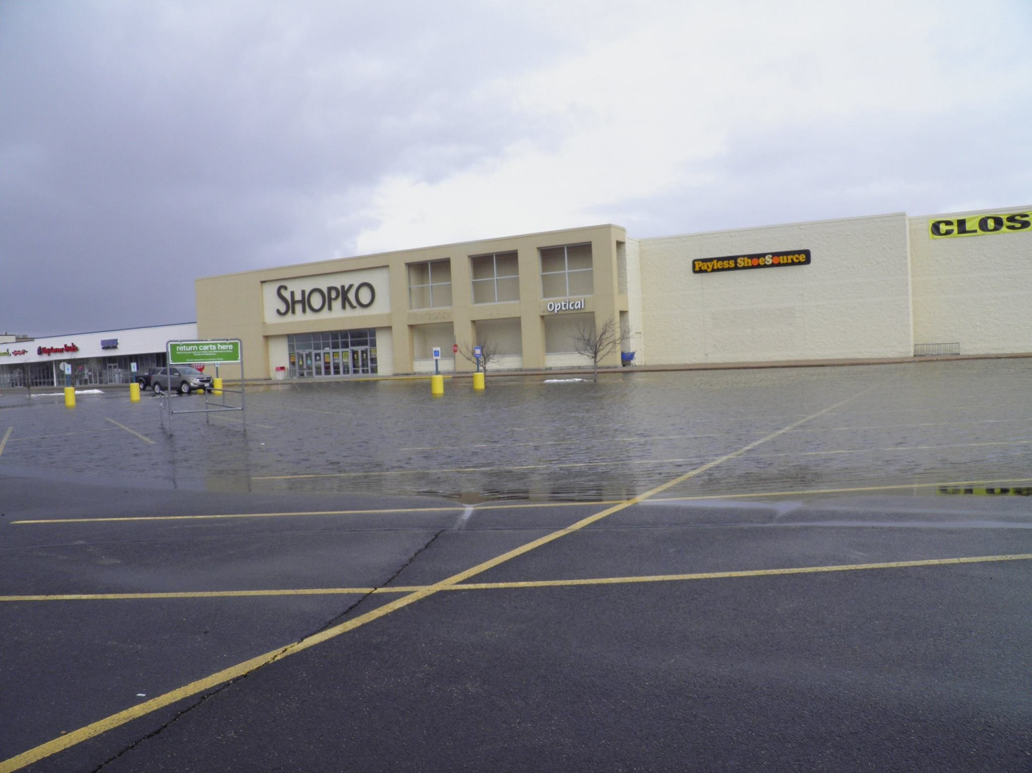 Water floods the parking lot of the Shopko in Plover on Friday, March 15, 2019.