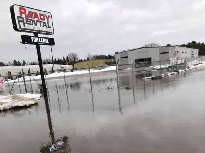 A sign for the former Ready Rental stands in water off of Post Road in Plover on Friday, March 15, 2019.
