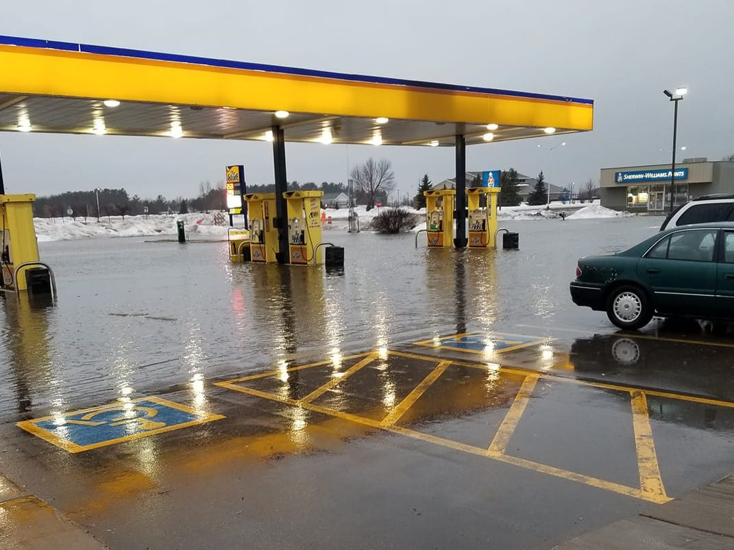 Tiffany Rodgers shared this photo taken Thursday, March 14, 2019, at The Store gas station near the intersection of Portage County HH and Brilowski Road in Stevens Point. Employees had to leave their cars in the lot Thursday night and walk through thigh-high water, she said. They still haven't been able to get back to their cars.