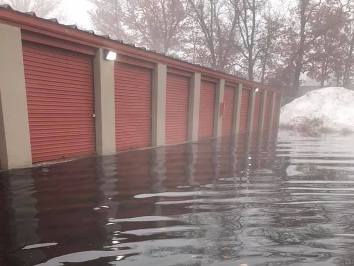 Flood water reaches the doors of storage sheds located on Church Street, near Blue Top, in Stevens Point on Friday, March 15, 2019.