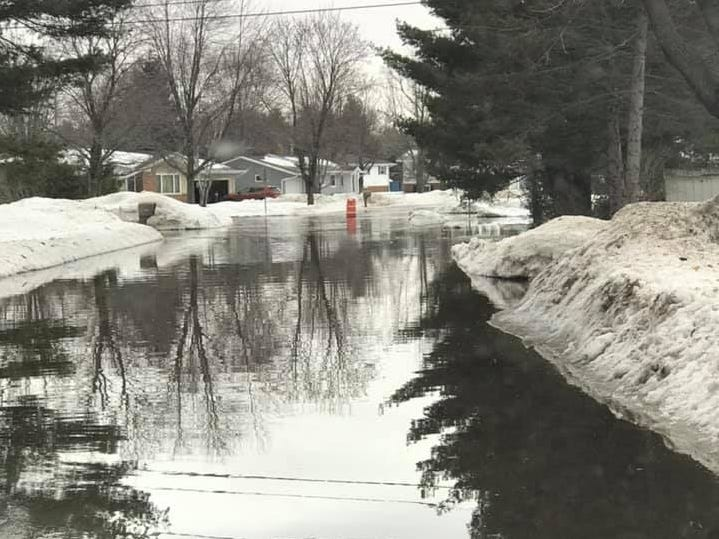 Water covers the roads at the corner of Sunset Boulevard and Simonis Street in the village of Park Ridge on Friday, March 15, 2019.