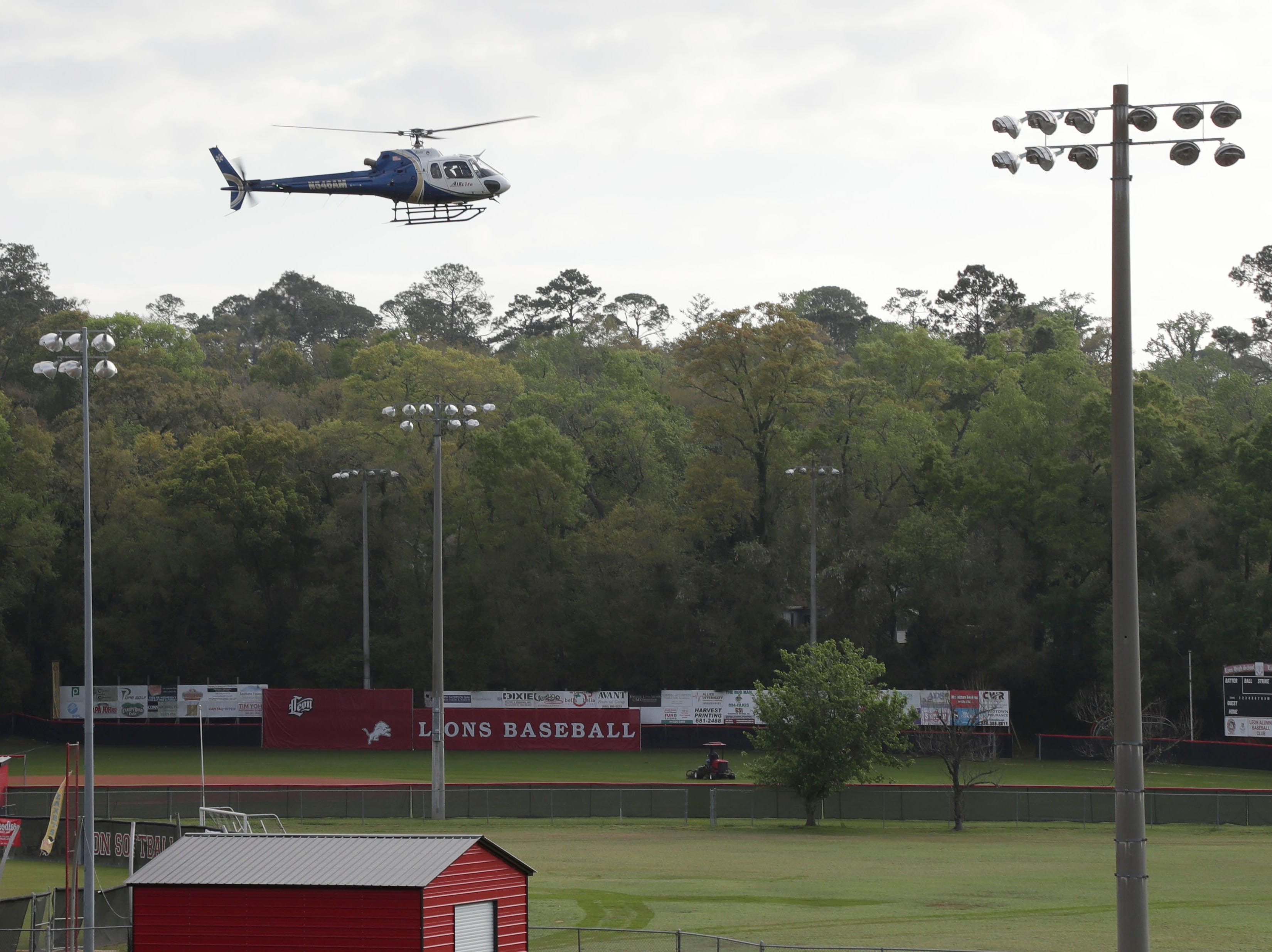 A helicopter arrives to Leon High School while students watch as Leon High School partners with the county safety officials to give a simulation on the consequences of drunk driving before the students leave for spring break Friday, March 15, 2019.
